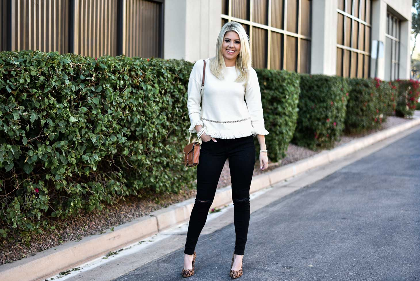 Erin Elizabeth of Wink and a Twirl in Cream Fringe Top by VIS