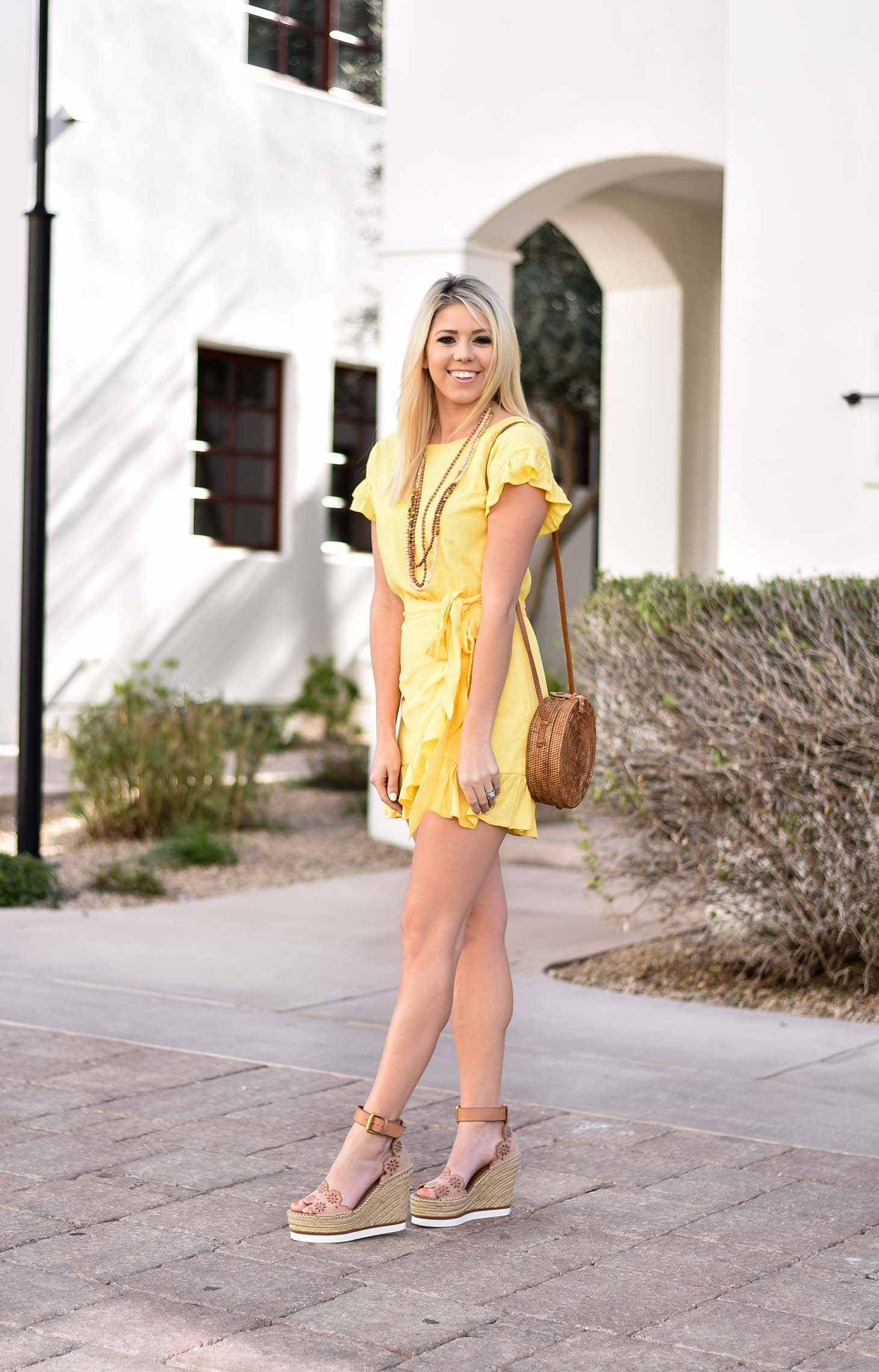 Erin Elizabeth of Wink and a Twirl in Yellow Spring Dress