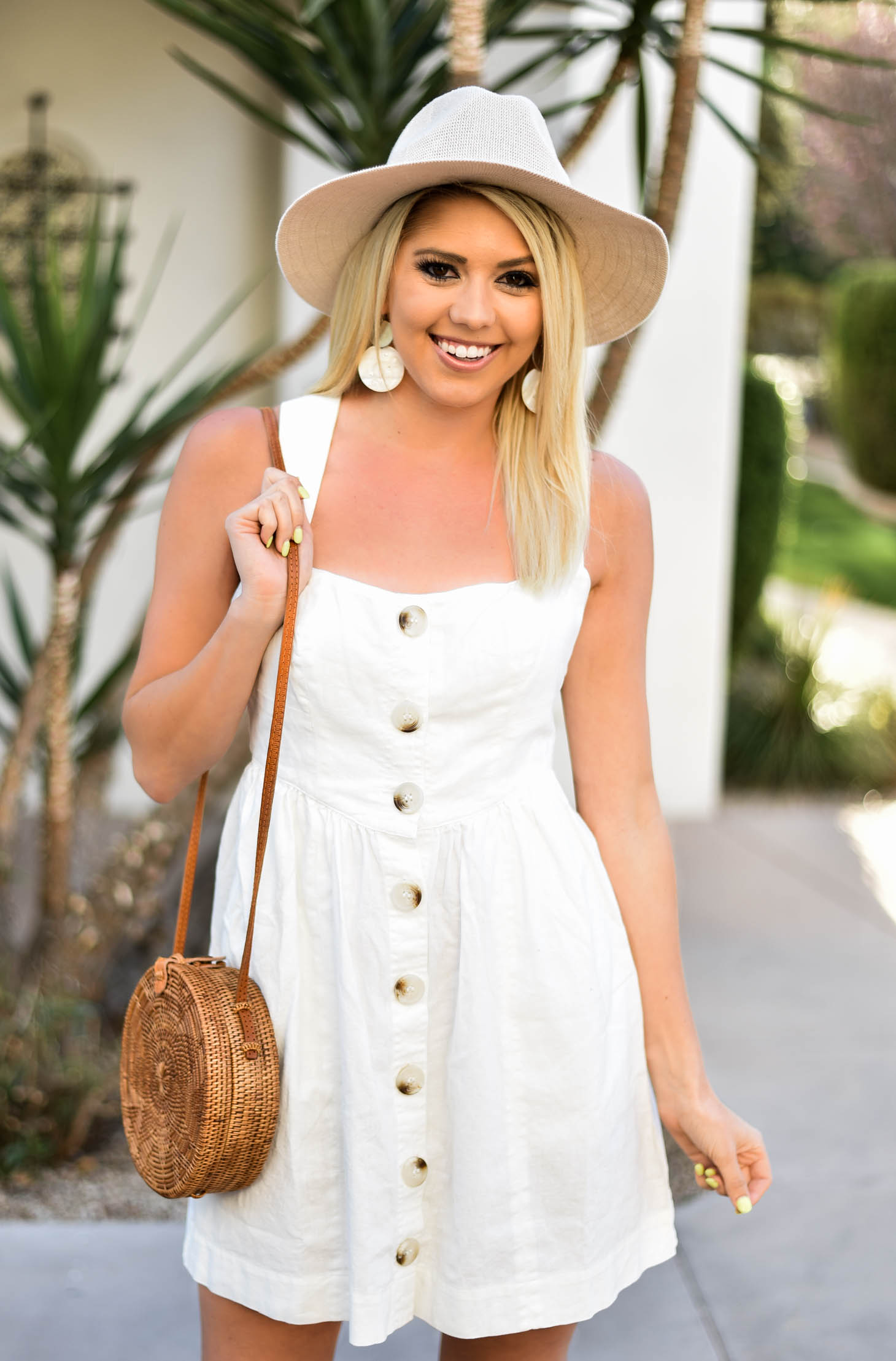 Erin Elizabeth of Wink and a Twirl in Free People White Spring Dress