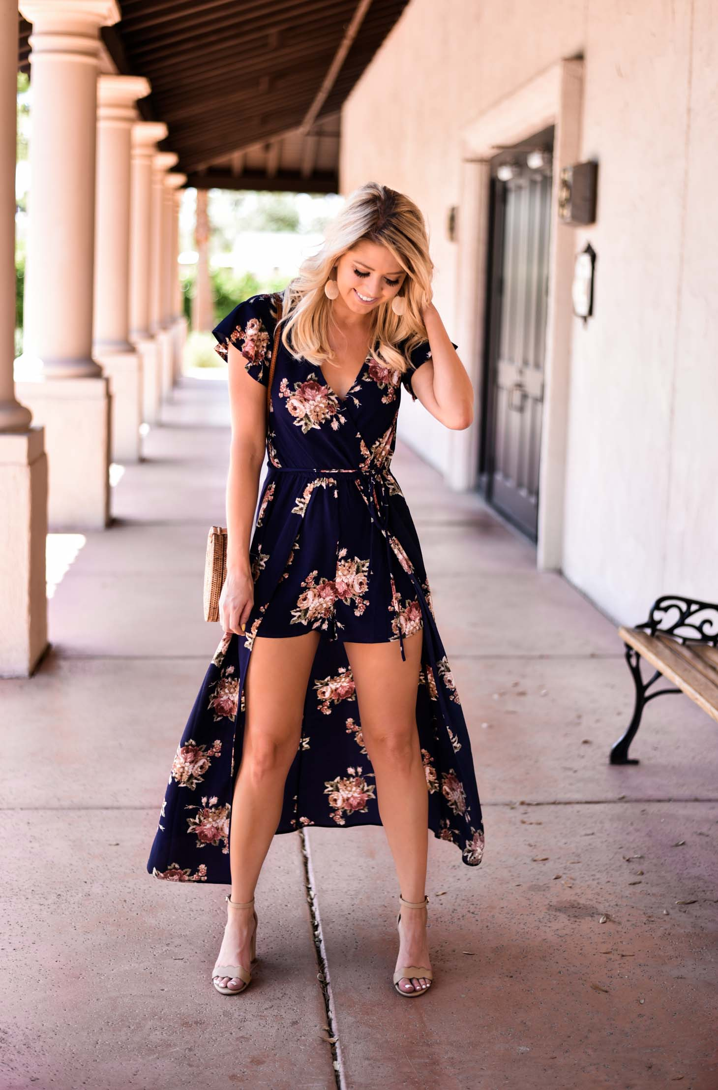 Erin Elizabeth of Wink and a Twirl in Neugent Spring Floral Romper Dress