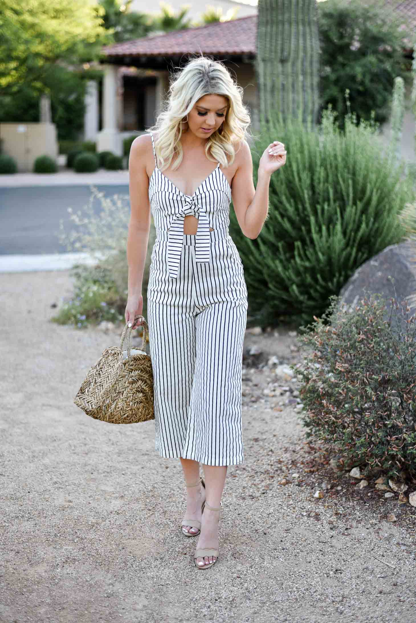 Erin Elizabeth of Wink and a Twirl shares this Mason Jar Boutique Striped Jumpsuit with cutout and tie detail for summer style