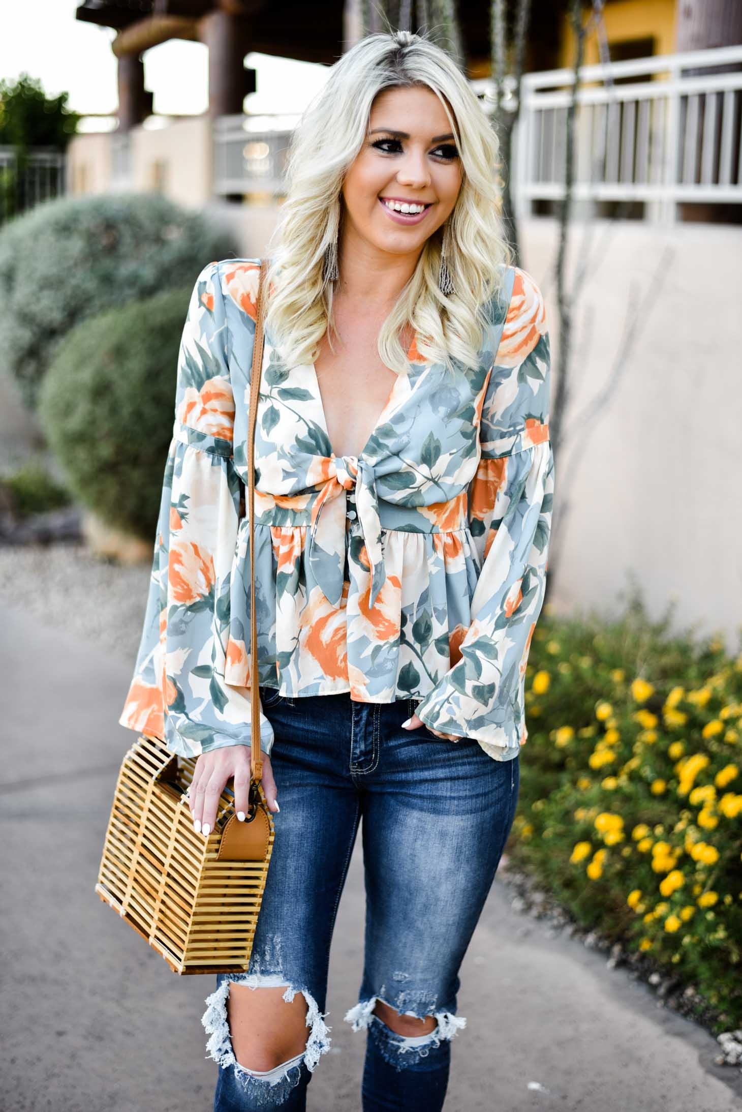 Erin Elizabeth of Wink and a Twirl in this Vici Dolls Jeans and Summer Floral Top
