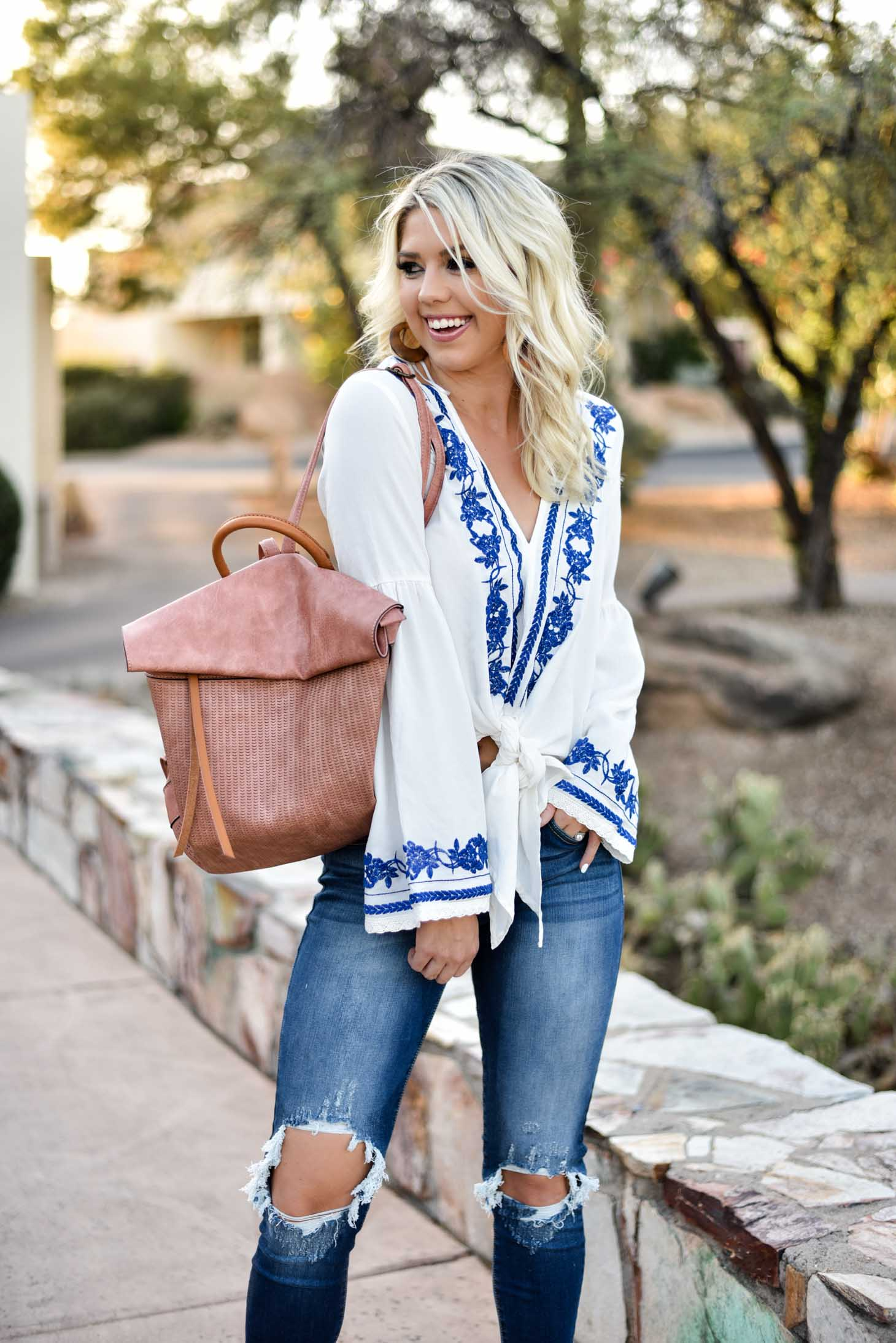 Erin Elizabeth of Wink and a Twirl in this Vici Dolls embroidered top jeans and blush backpack style perfect for summer