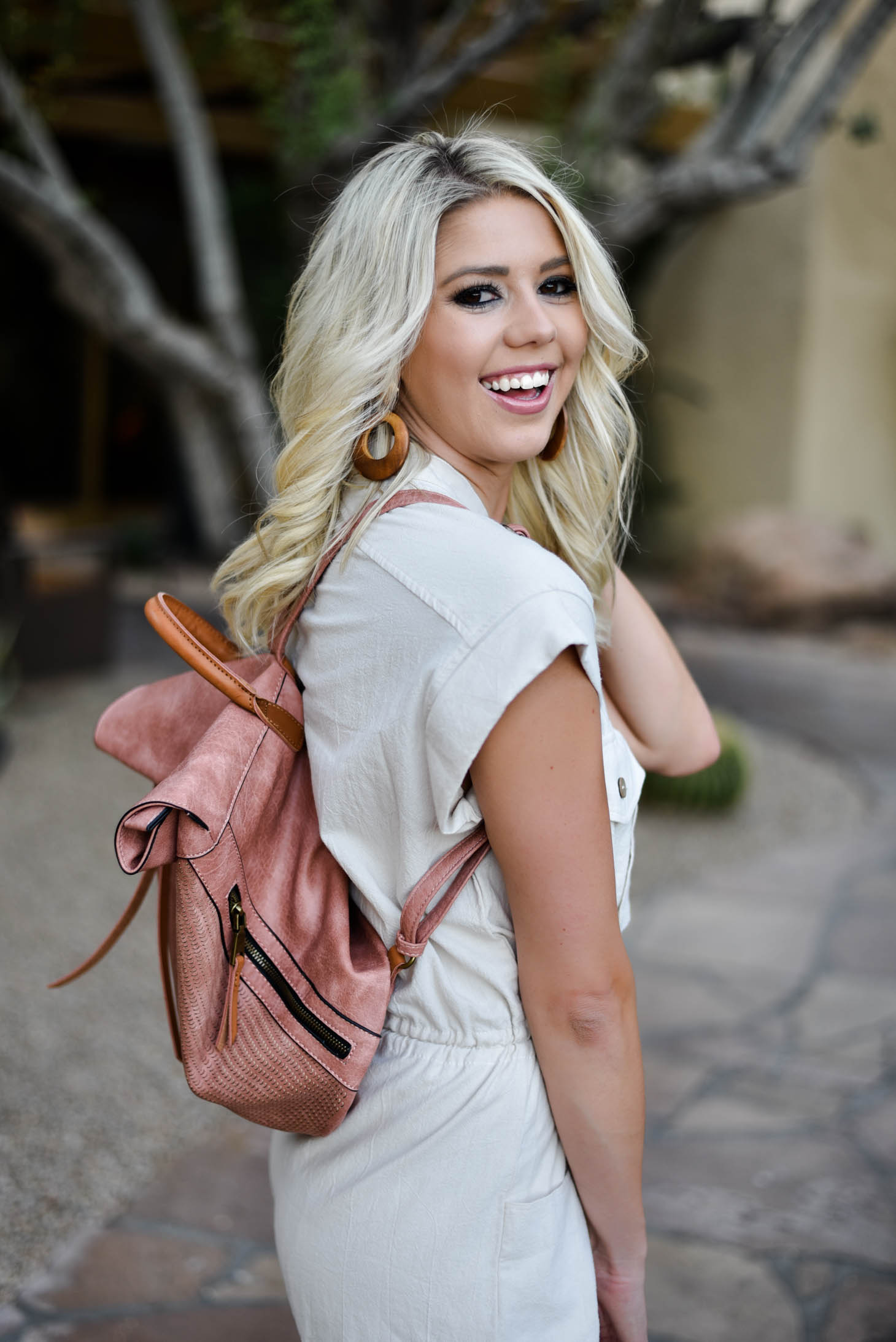 Erin Elizabeth of Wink and a Twirl in this Vici Dolls Tie Romper and Backpack Summer Style