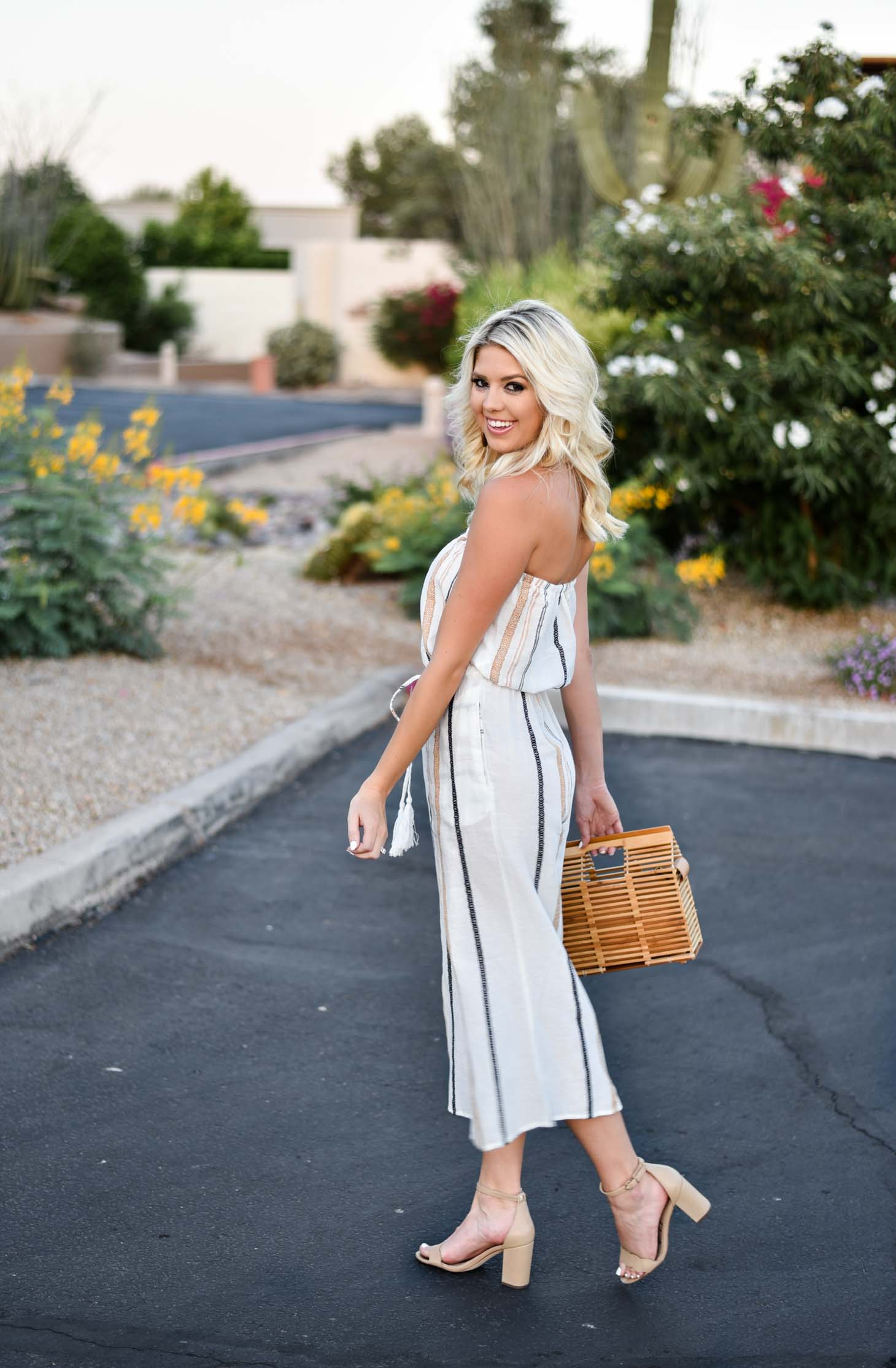 Erin Elizabeth of Wink and a Twirl shares this Vici Dolls striped jumpsuit and bamboo bag perfect for summer