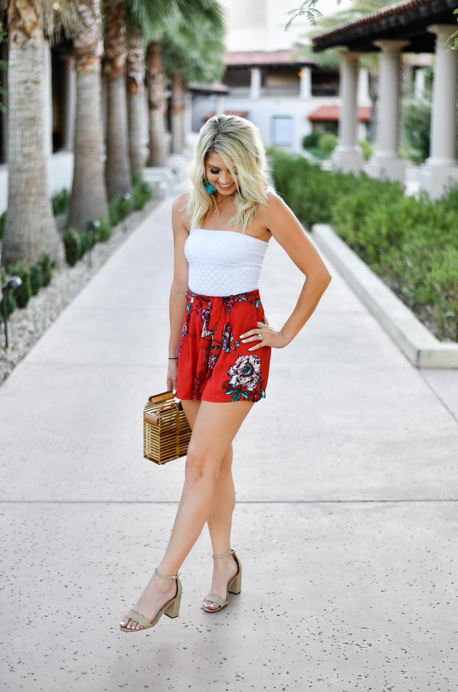Erin Elizabeth of Wink and a Twirl shares this Shop the Mint floral shorts Summer style outfit