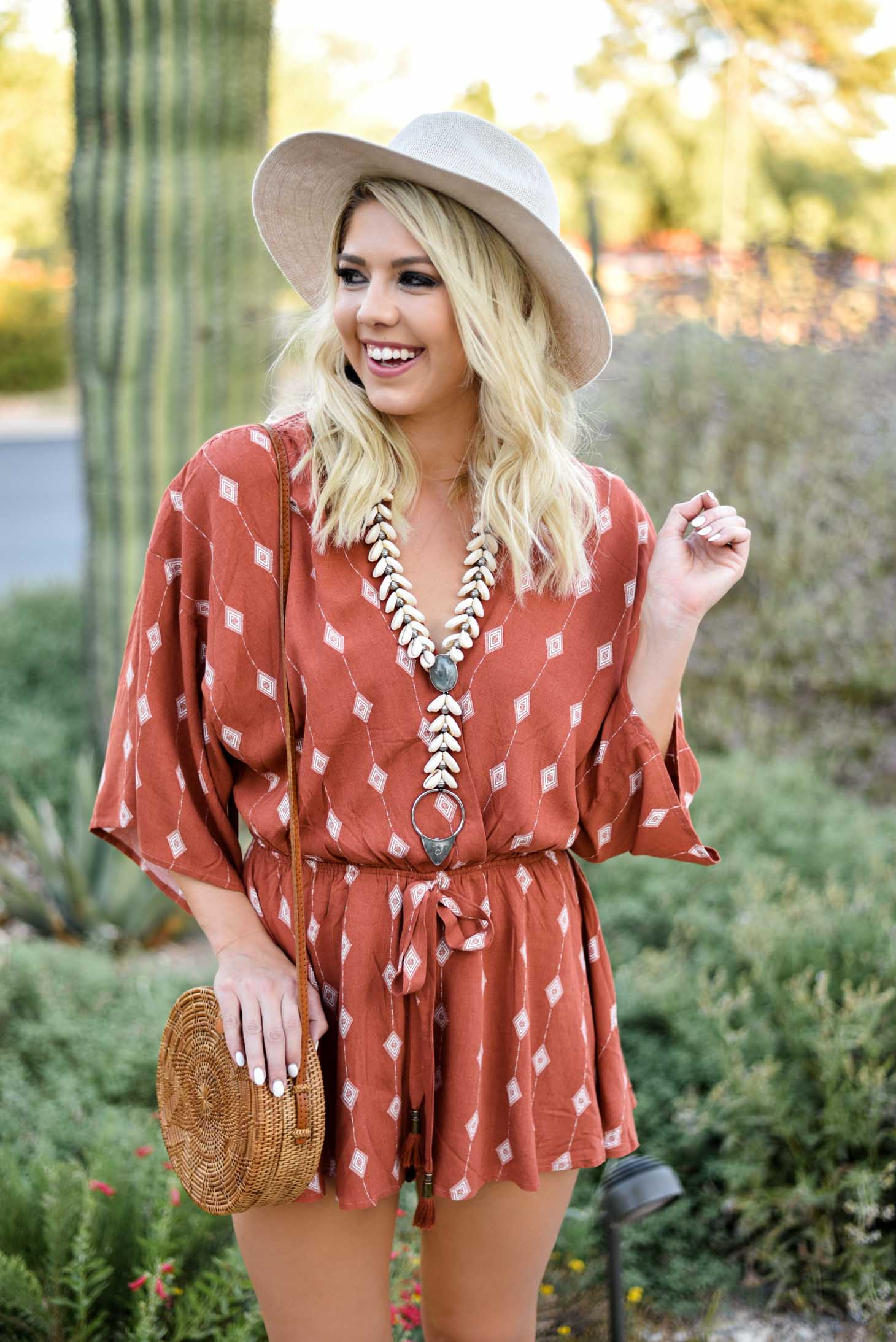 Erin Elizabeth of Wink and a Twirl I'm this summer romper from Red Dress Boutique