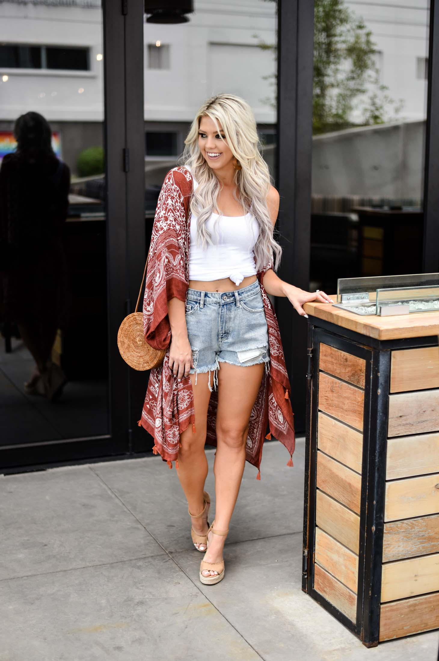 Erin Elizabeth of Wink and a Twirl shares the cutest casual summer look with Vici Dolls with a kimono and denim shorts