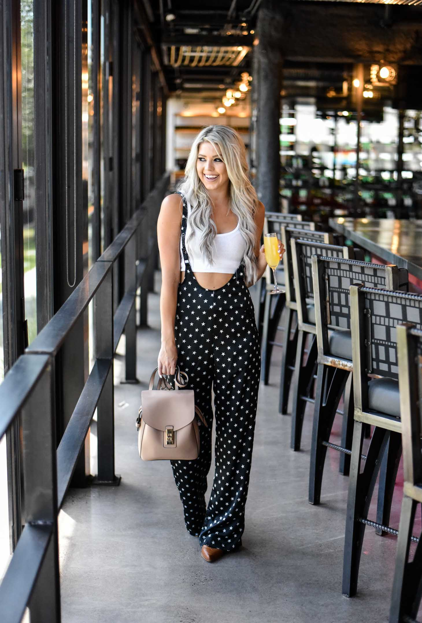 Erin Elizabeth of Wink and a Twirl in these star print pants and white tank perfect for your summer style