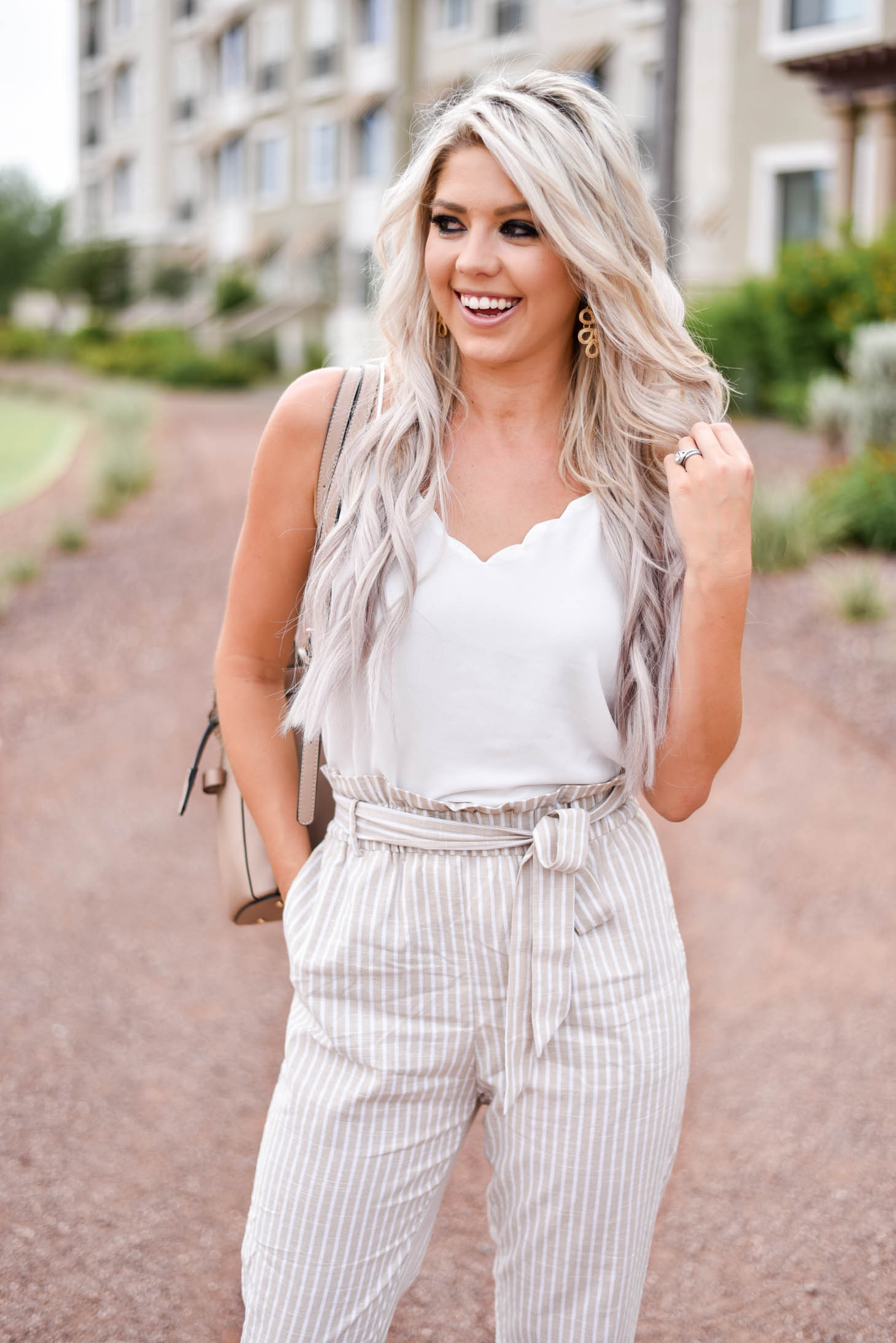 Erin Elizabeth of Wink and a Twirl shares this Red Dress Boutique look with the cutest highwaist pants ad white cami