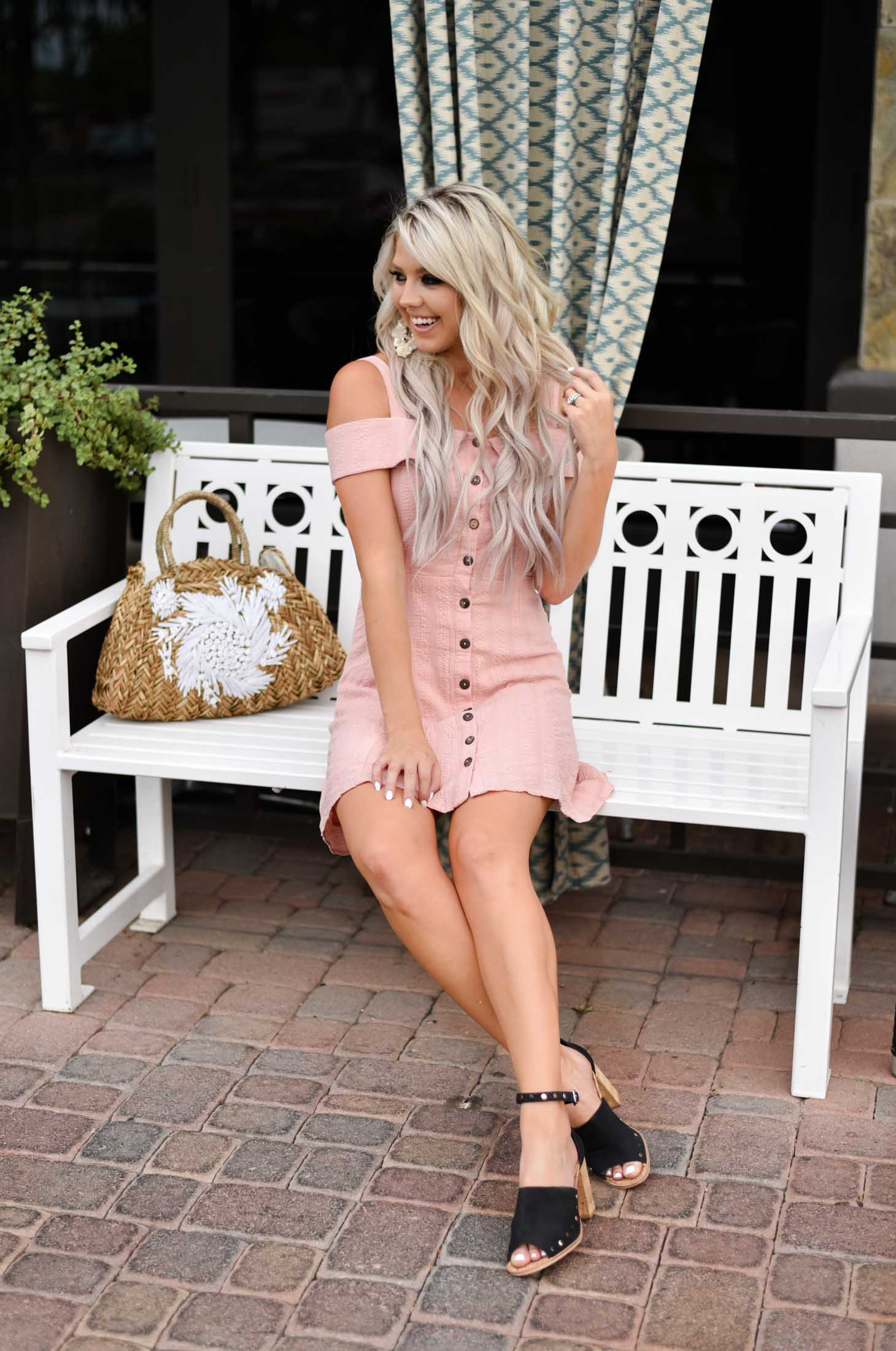 Erin Elizabeth of Wink and a Twirl shares the cutest off the shoulder dress from Bella Bella Boutique