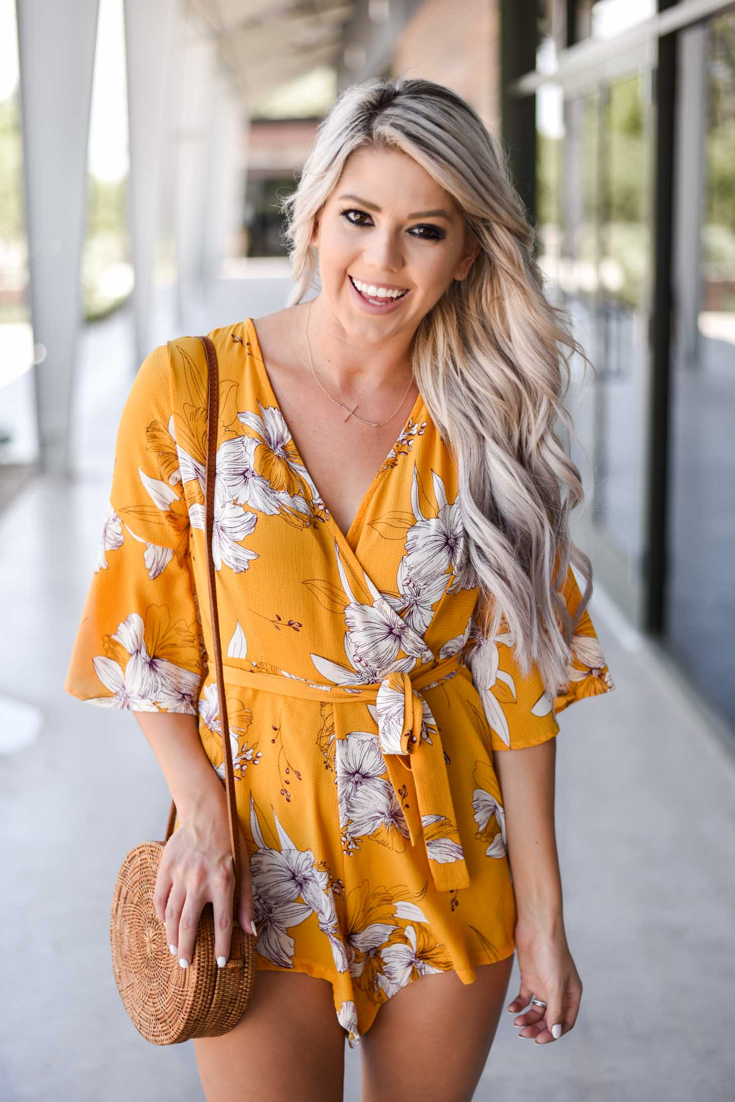 Erin Elizabeth of Wink and a Twirl shares this cute yellow romper from Chicwish perfect for Summer and Fall style
