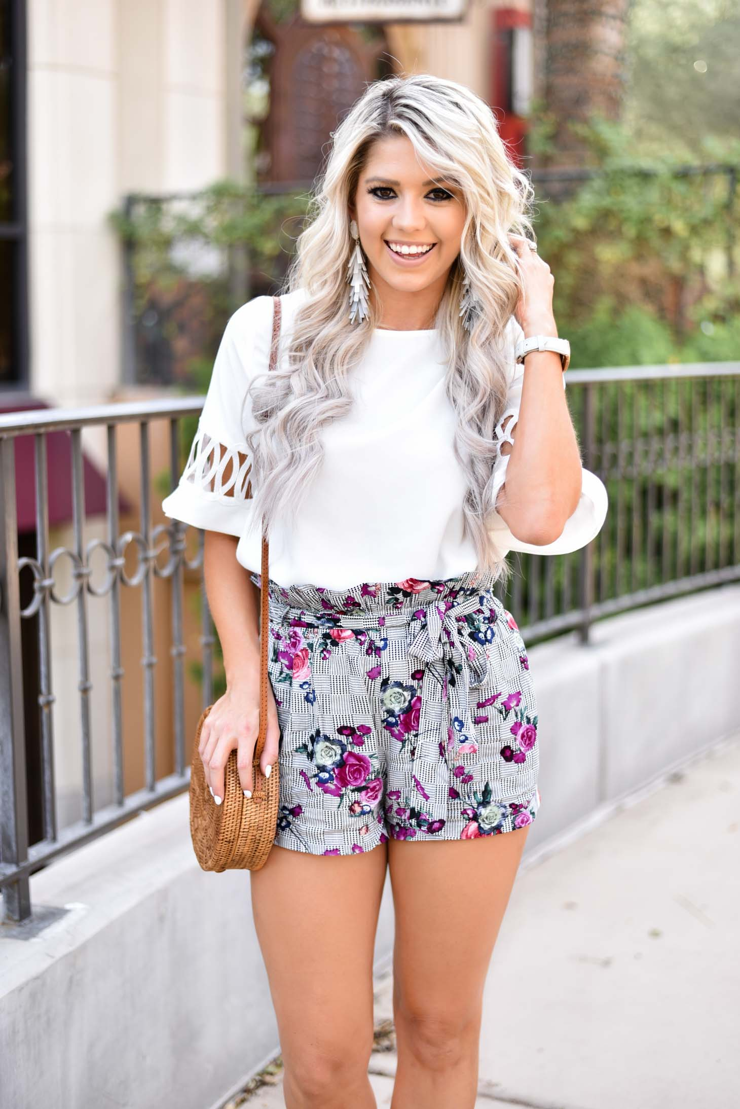 Erin Elizabeth of Wink and a Twirl shares the cutest pair of high waist shorts and white blouse from Shop Sugar Lips
