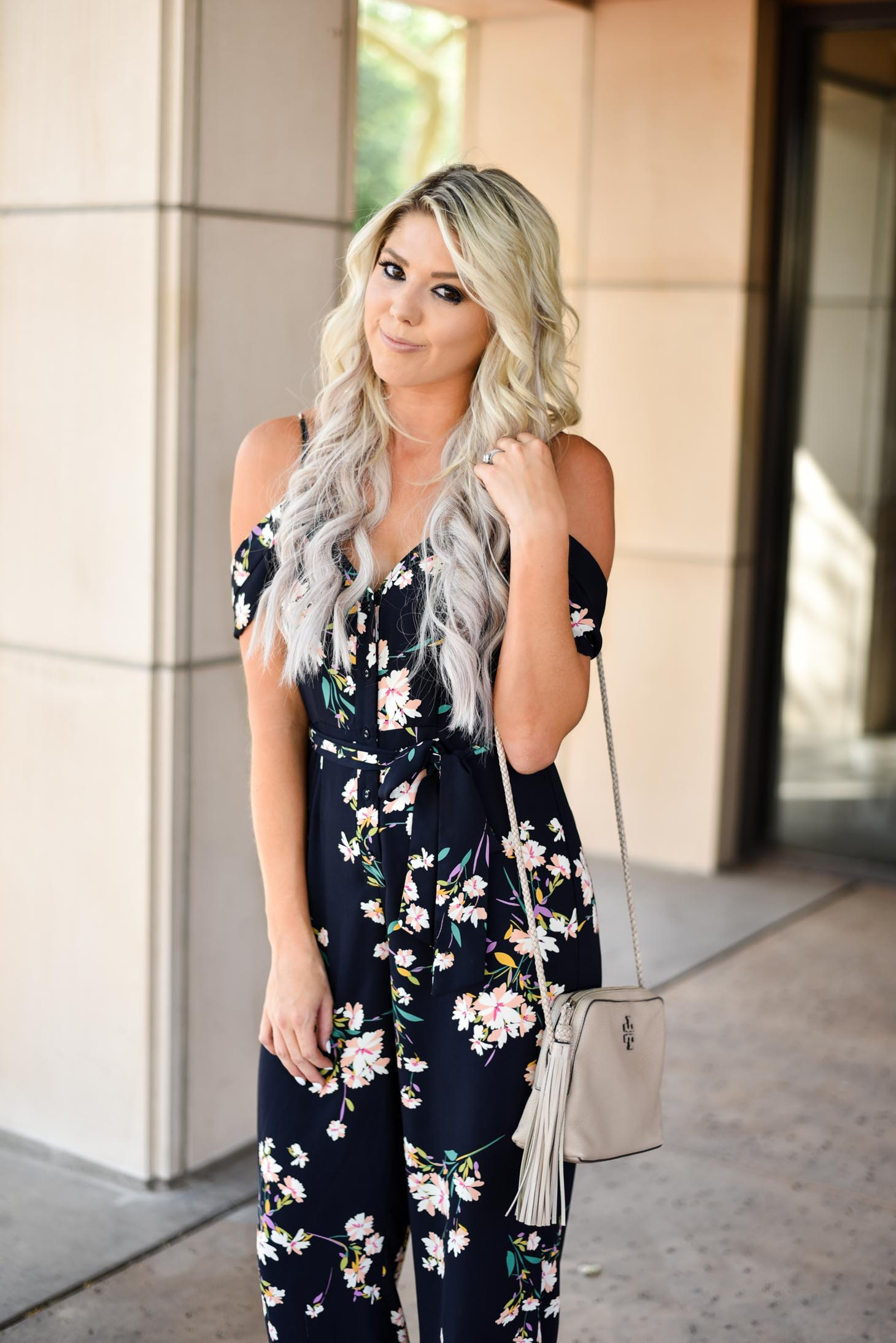 Erin Elizabeth of Wink and a Twirl in this Shop Sugar Lips floral jumpsuit