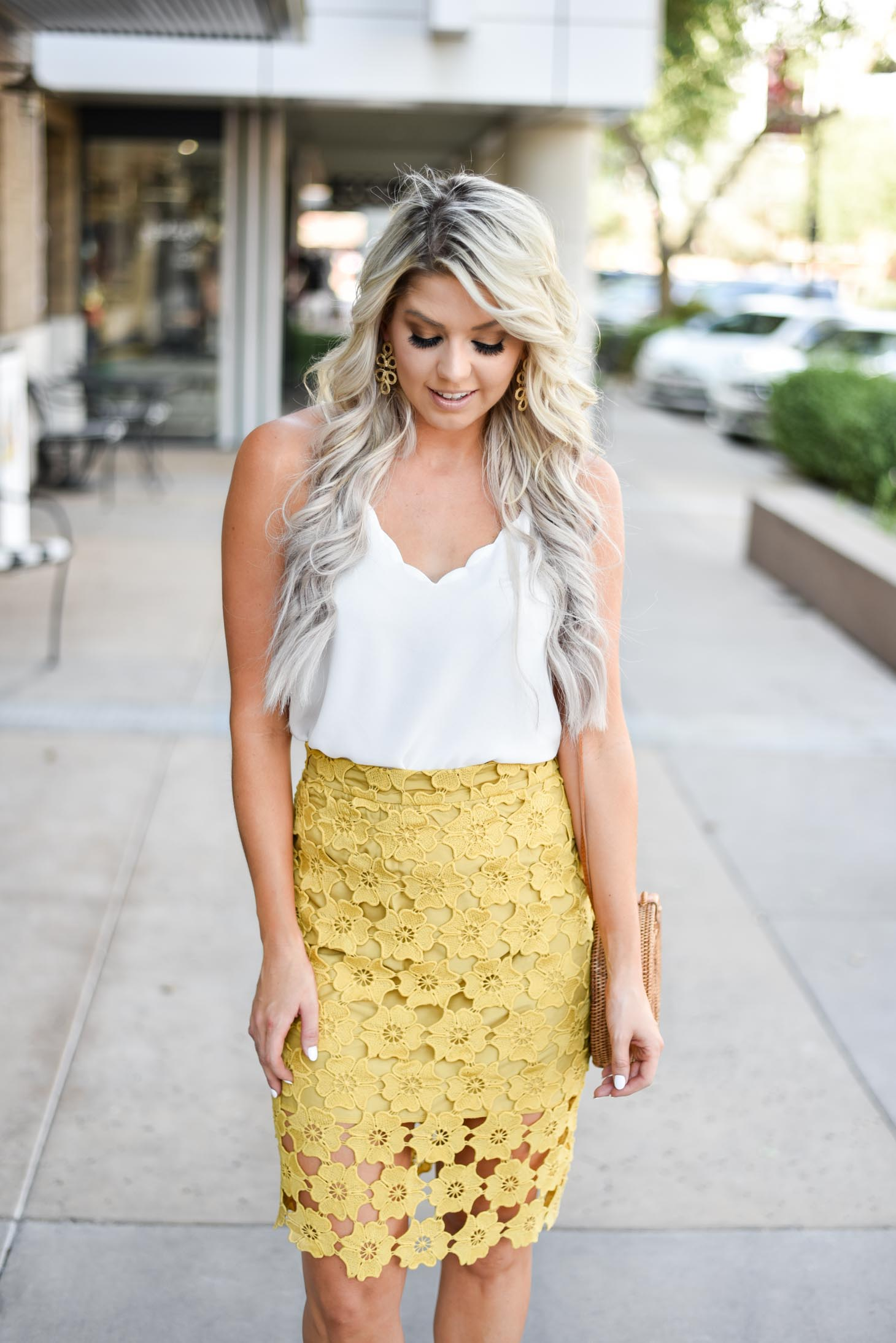Erin Elizabeth of Wink and a Twirl shares the cutest yellow lace midi skirt