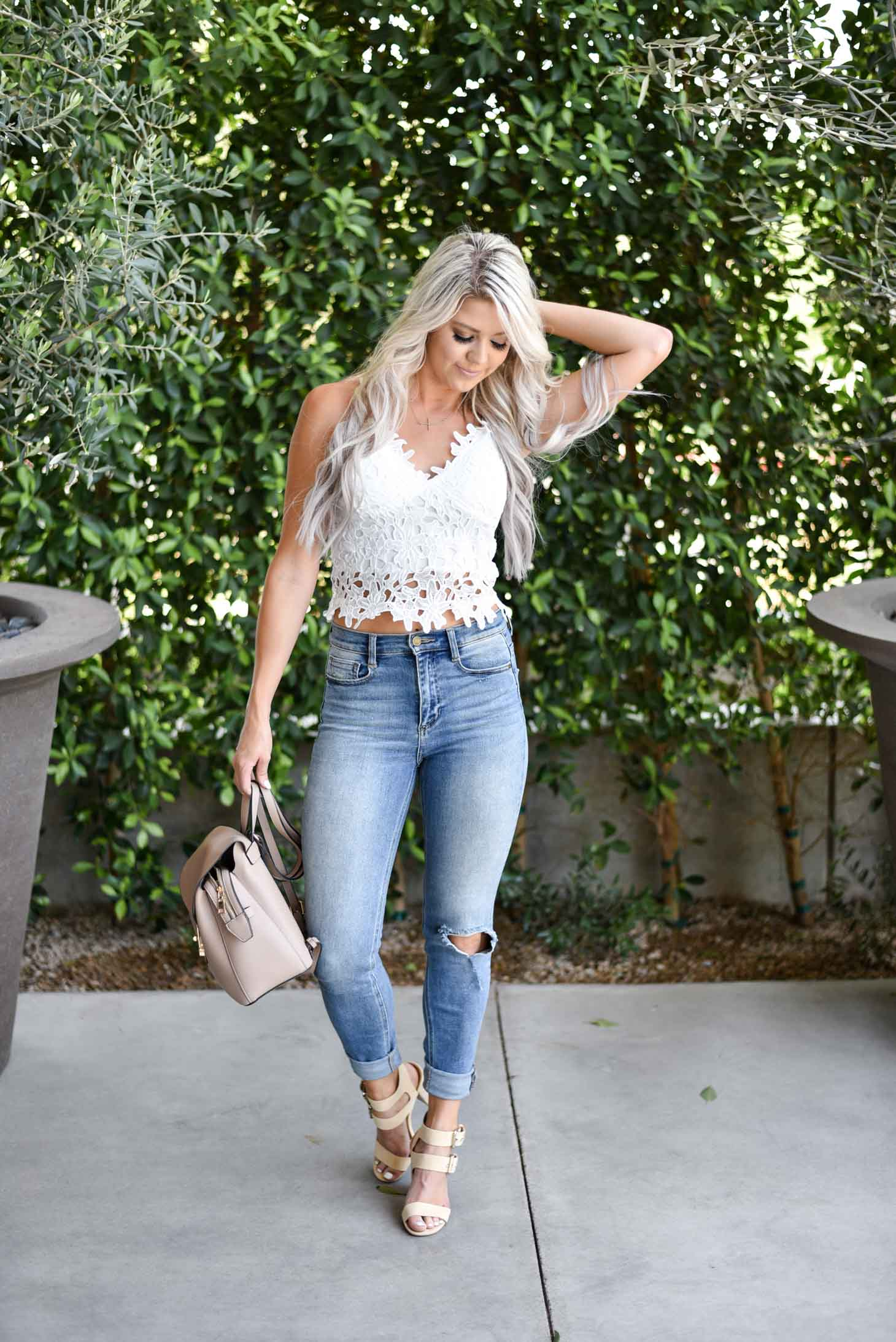 Erin Elizabeth of Wink and a Twirl in this cute white lace cami from Chicwish