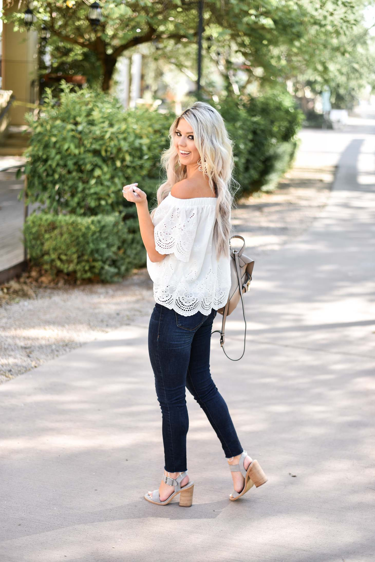 Erin Elizabeth of Wink and a Twirl shares the cutest white eyelet off the shoulder top from Jess Lea Boutique