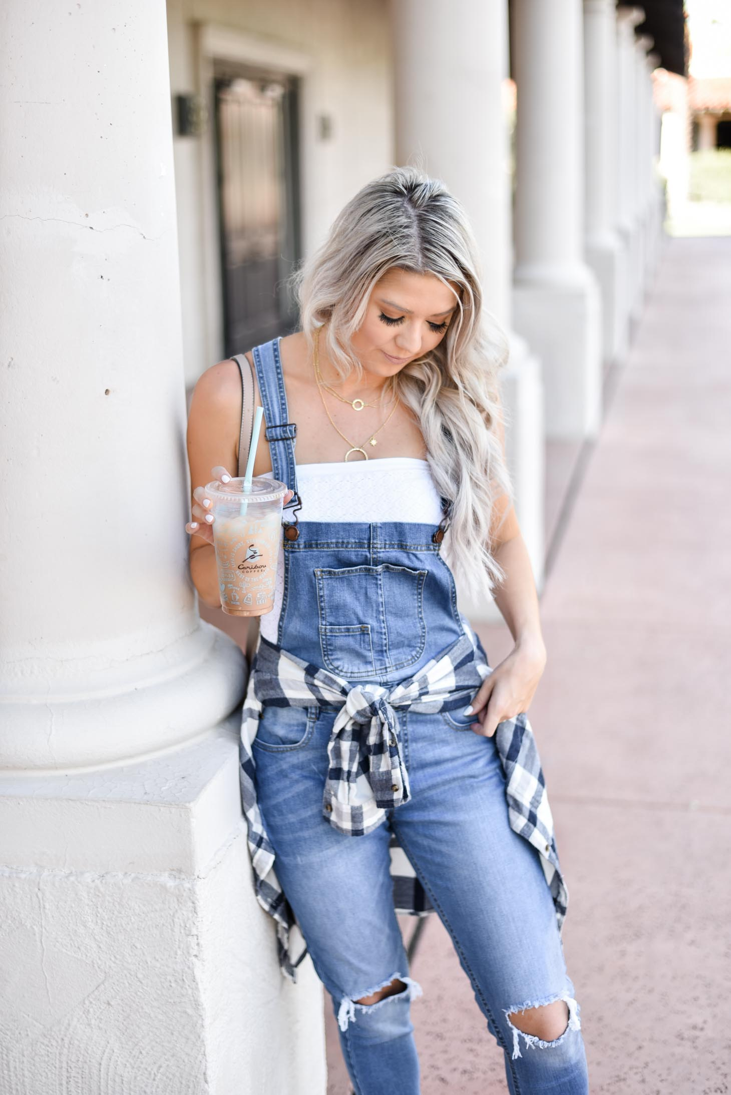 Erin Elizabeth of Wink and a Twirl shares the overall jeans you need from Pink Lily Boutique this Fall