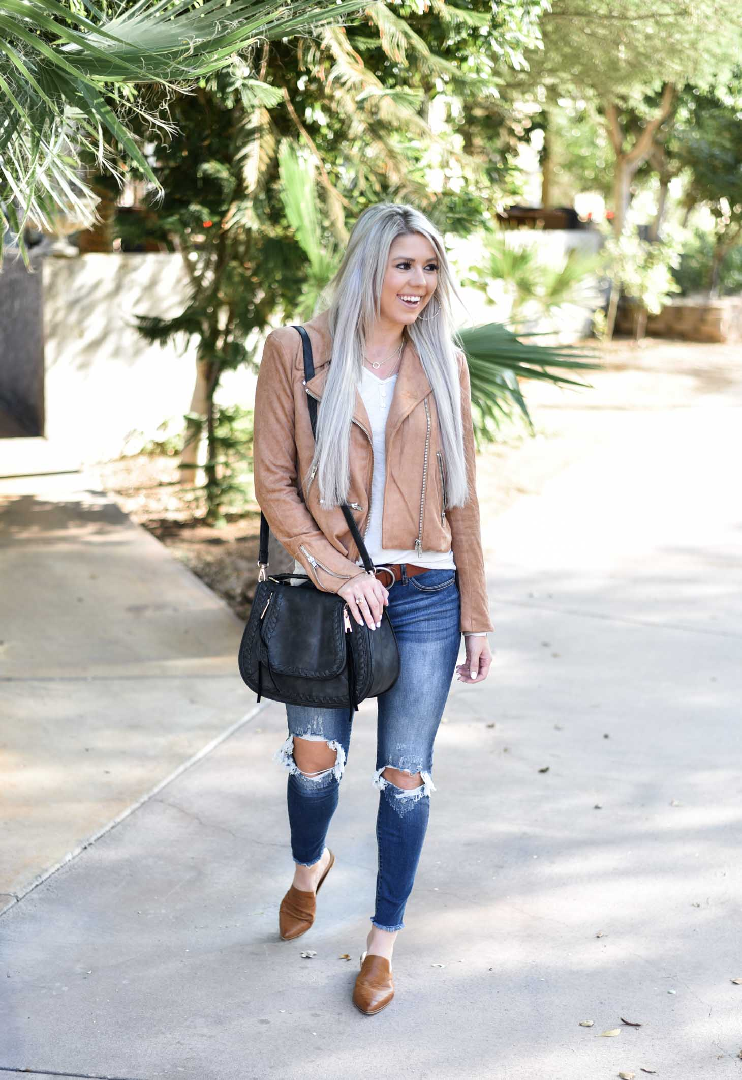 Erin Elizabeth of Wink and a Twirl shares the cutest Fall style Moto jacket from Vici Dolls