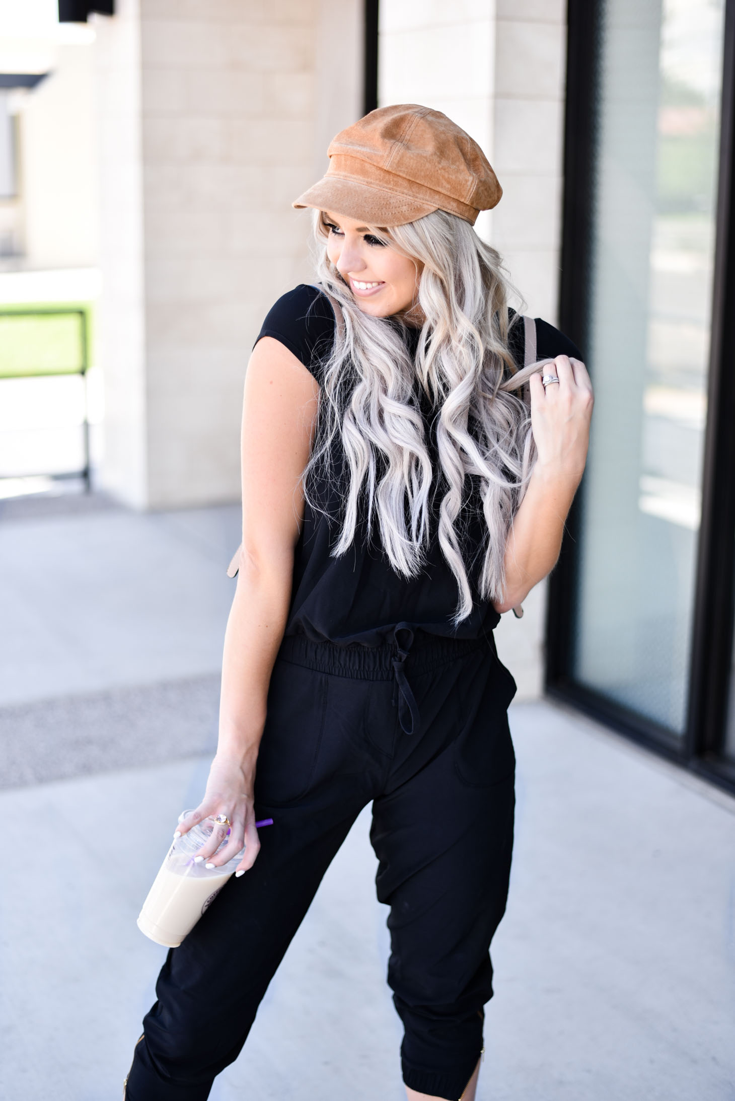 Erin Elizabeth of Wink and a Twirl share the cutest Albion Fit jumpsuit for their Jump for Jetsetters Campaign