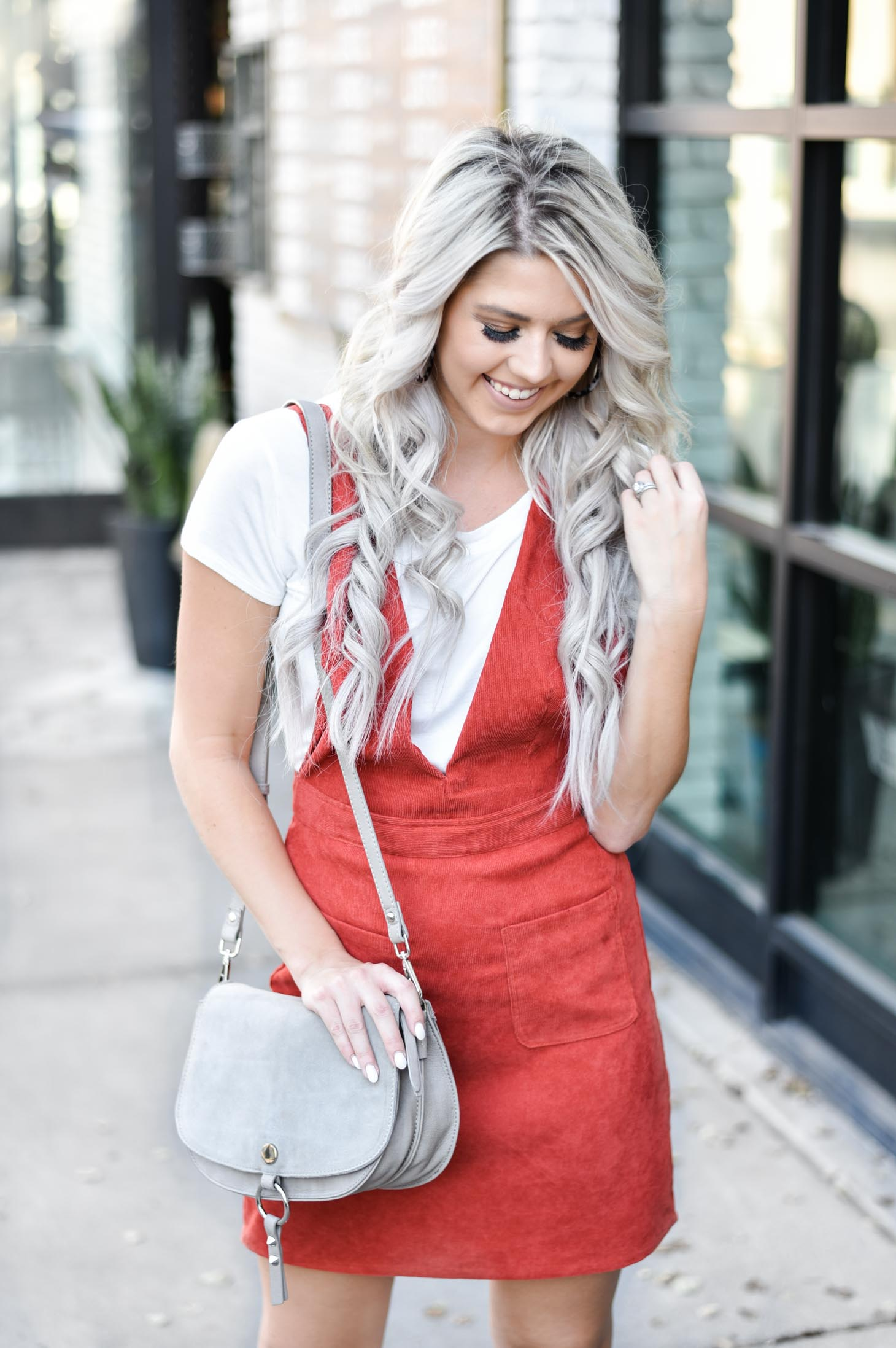 Erin Elizabeth of Wink and a Twirl share the cutest fall look with Red Dress Boutique Fall Jumper and White Booties