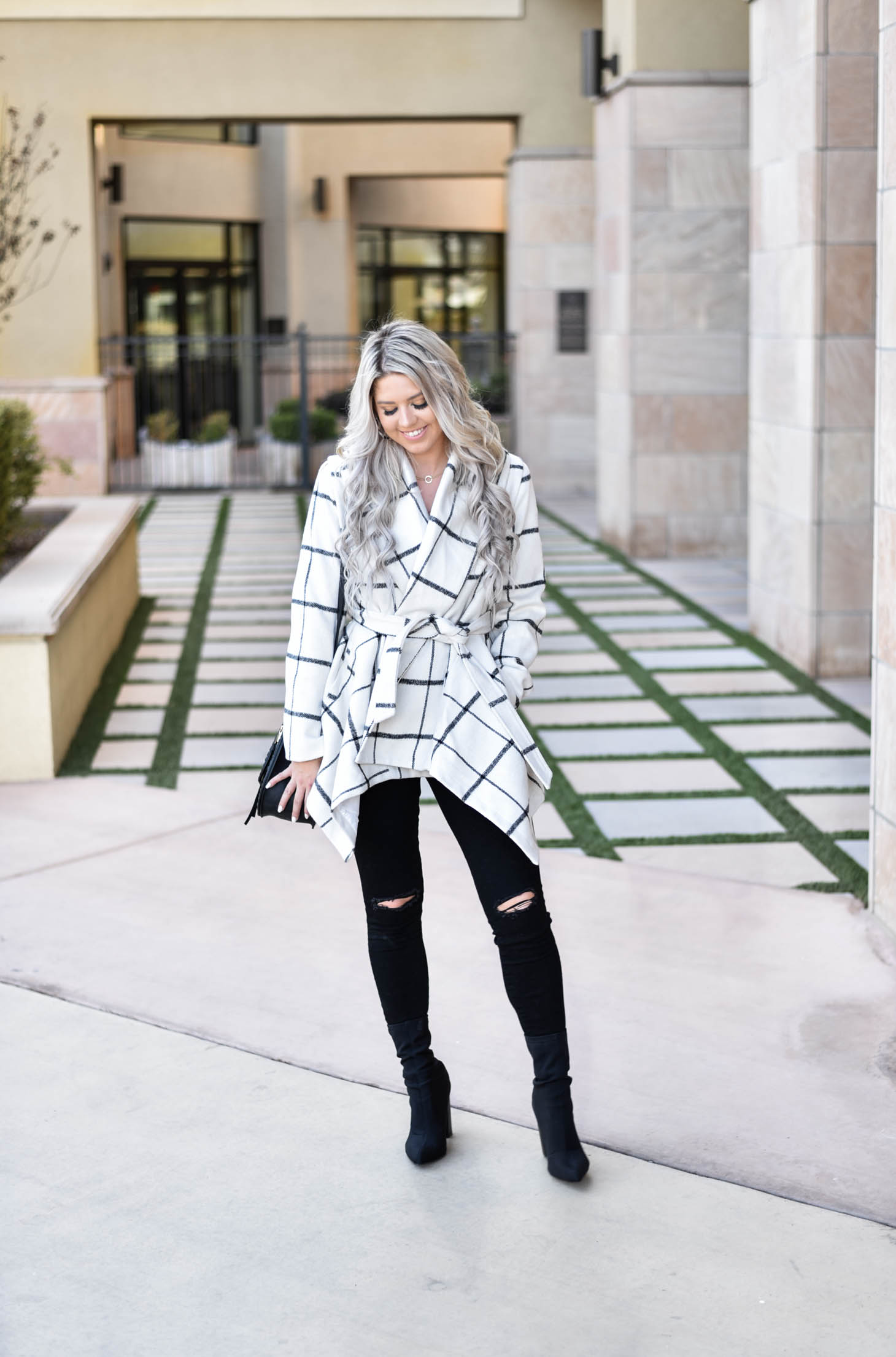 Erin Elizabeth of Wink and a Twirl shares the must have coat for Fall and Winter from Chicwish