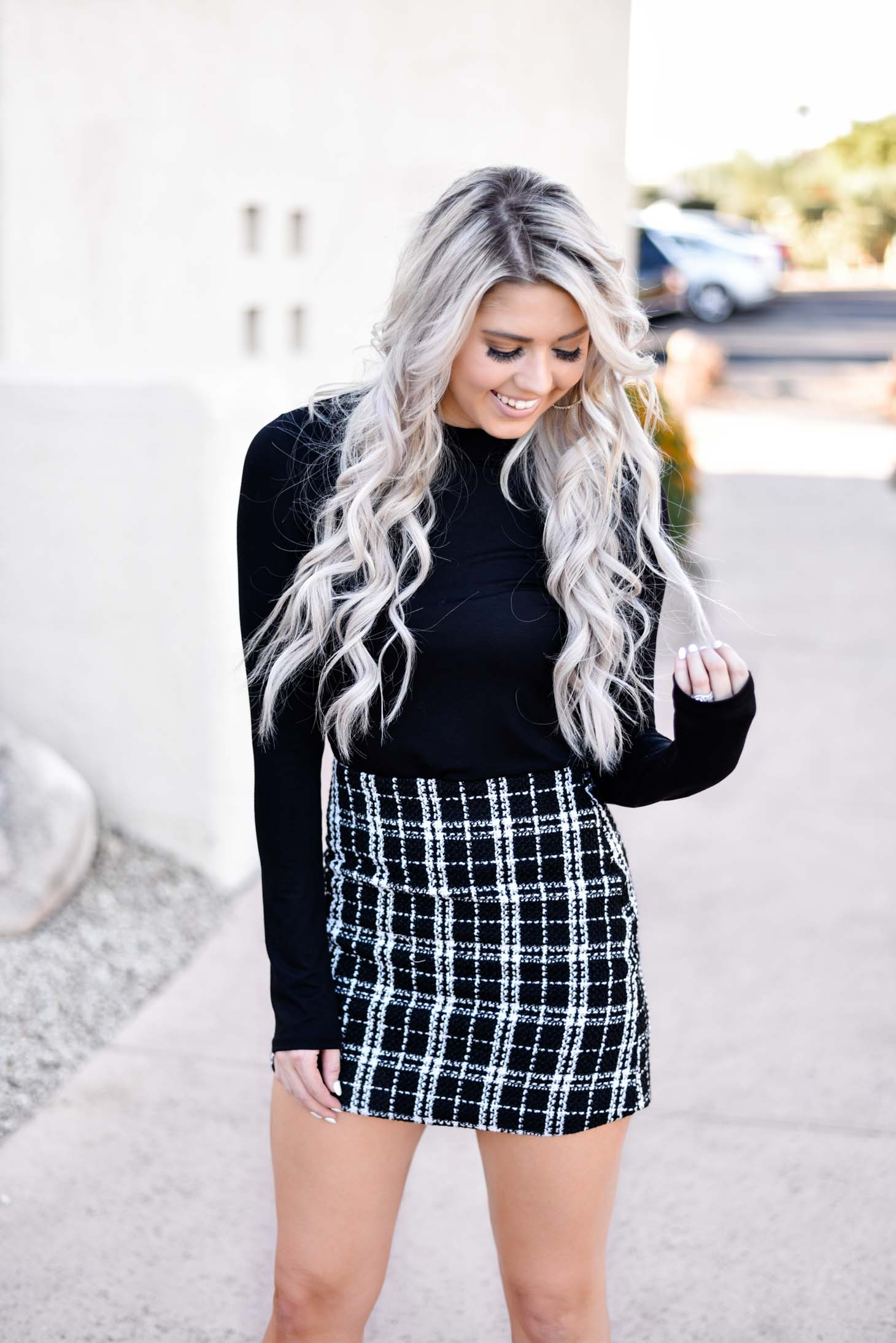 Erin Elizabeth of Wink and a Twirl share two ways to style a black long sleeve top from Pink Lily Boutique
