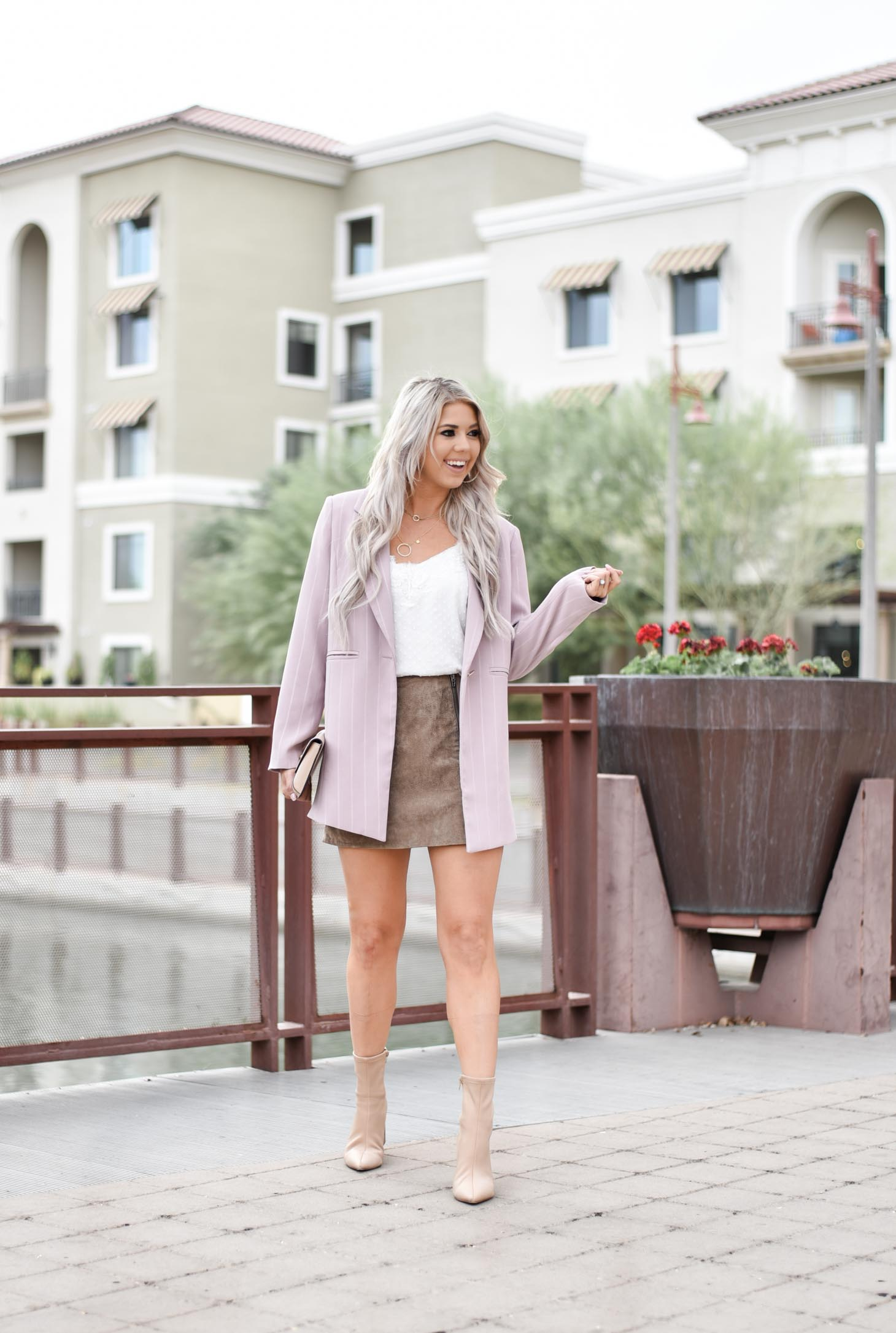 Erin Elizabeth of Wink and a Twirl shares the cutest pinstriped blush blazer from Chicwish