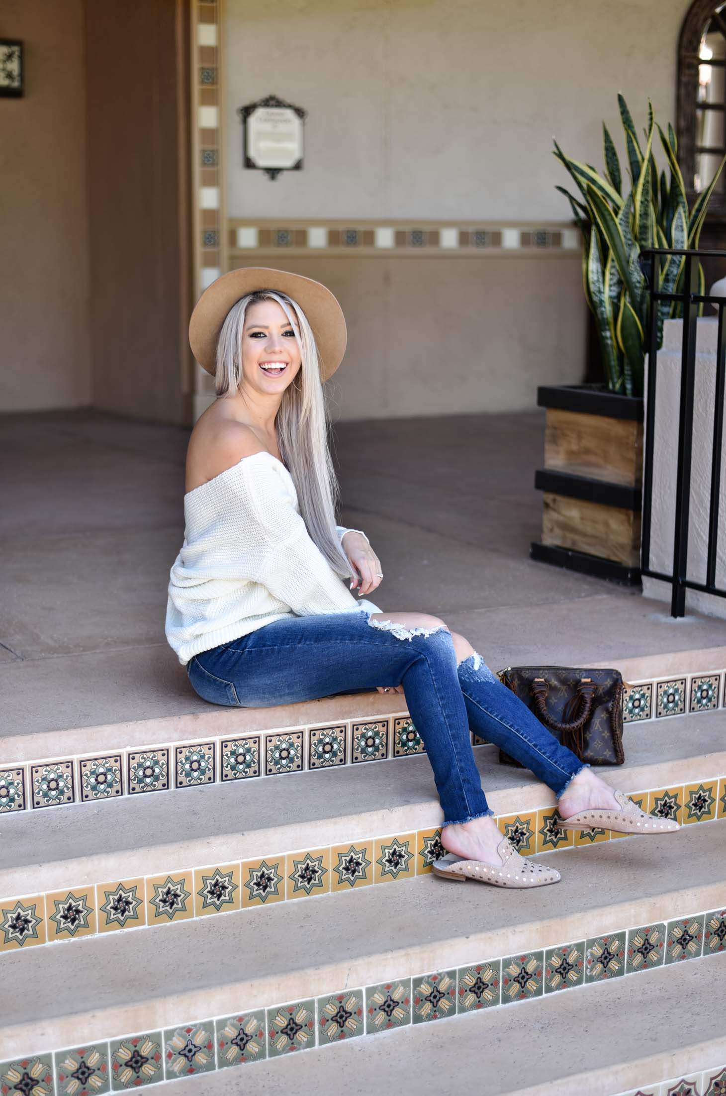 Erin Elizabeth of Wink and a Twirl shares the cutest off the shoulder sweater from Chicwish