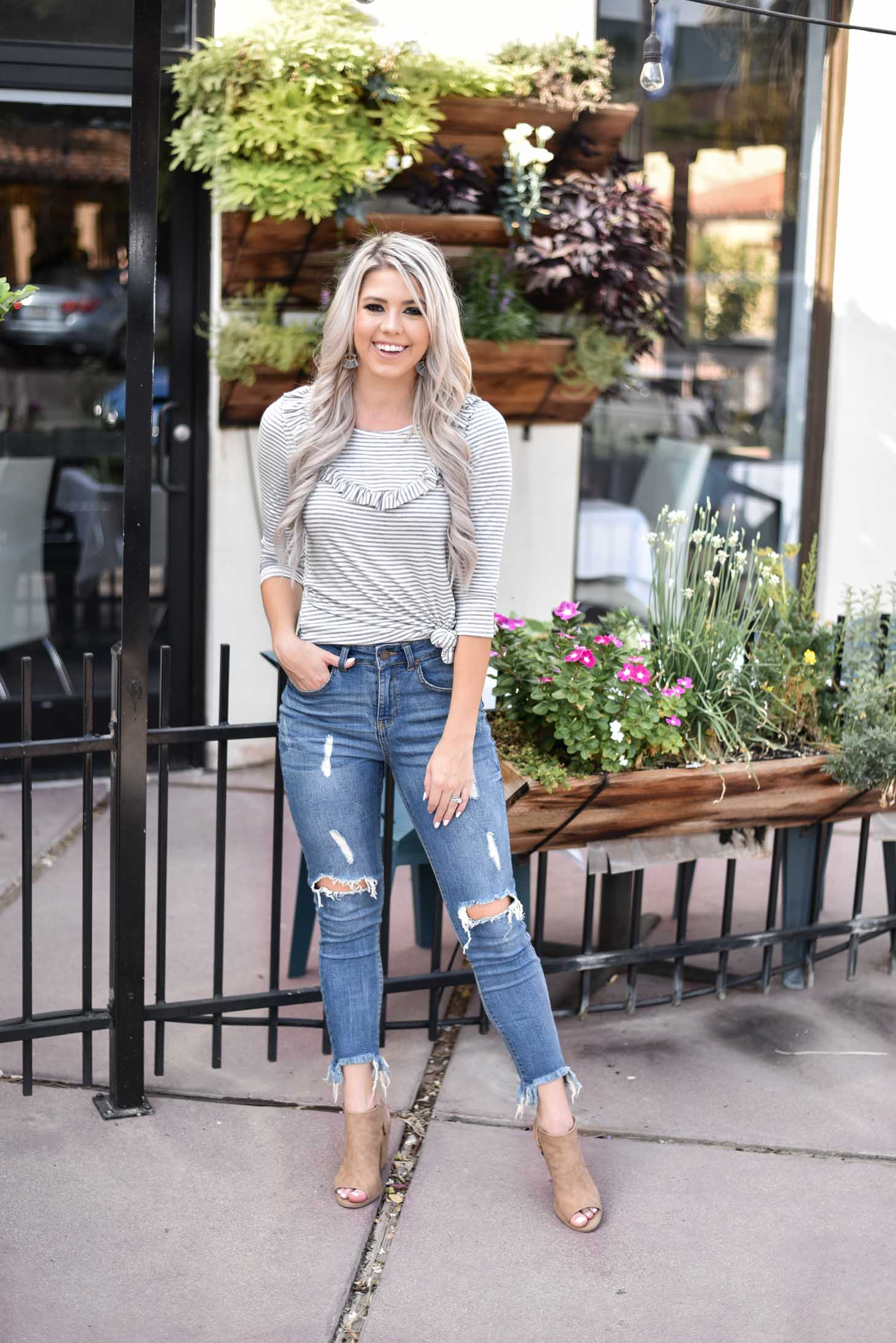 Erin Elizabeth of Wink and a Twirl shares two ways to style a Pink Lily Boutique striped top from day to night
