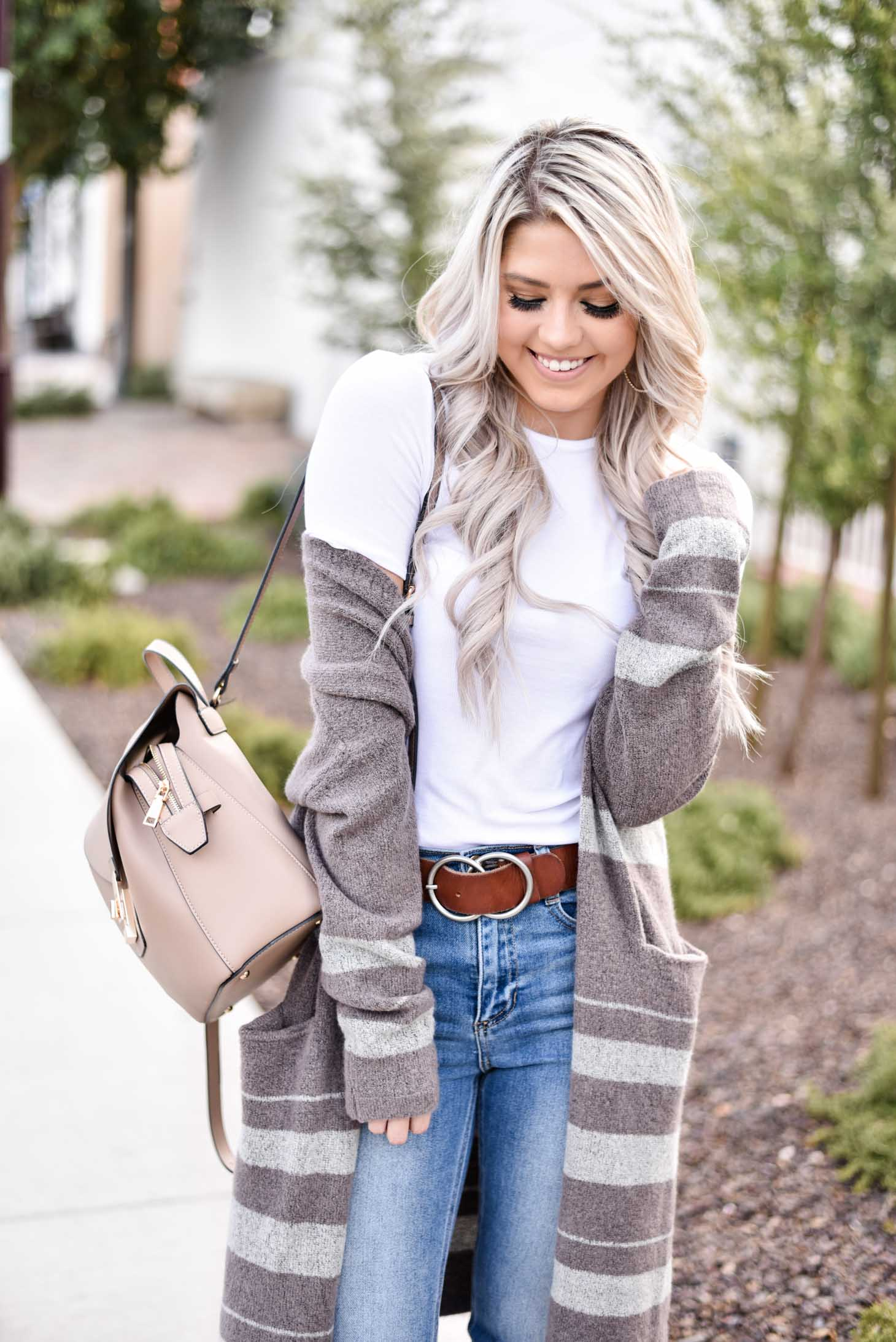 Erin Elizabeth of Wink and a Twirl share the cutest brown and white striped cardigan from Shop Sweet Olive perfect for layering this fall