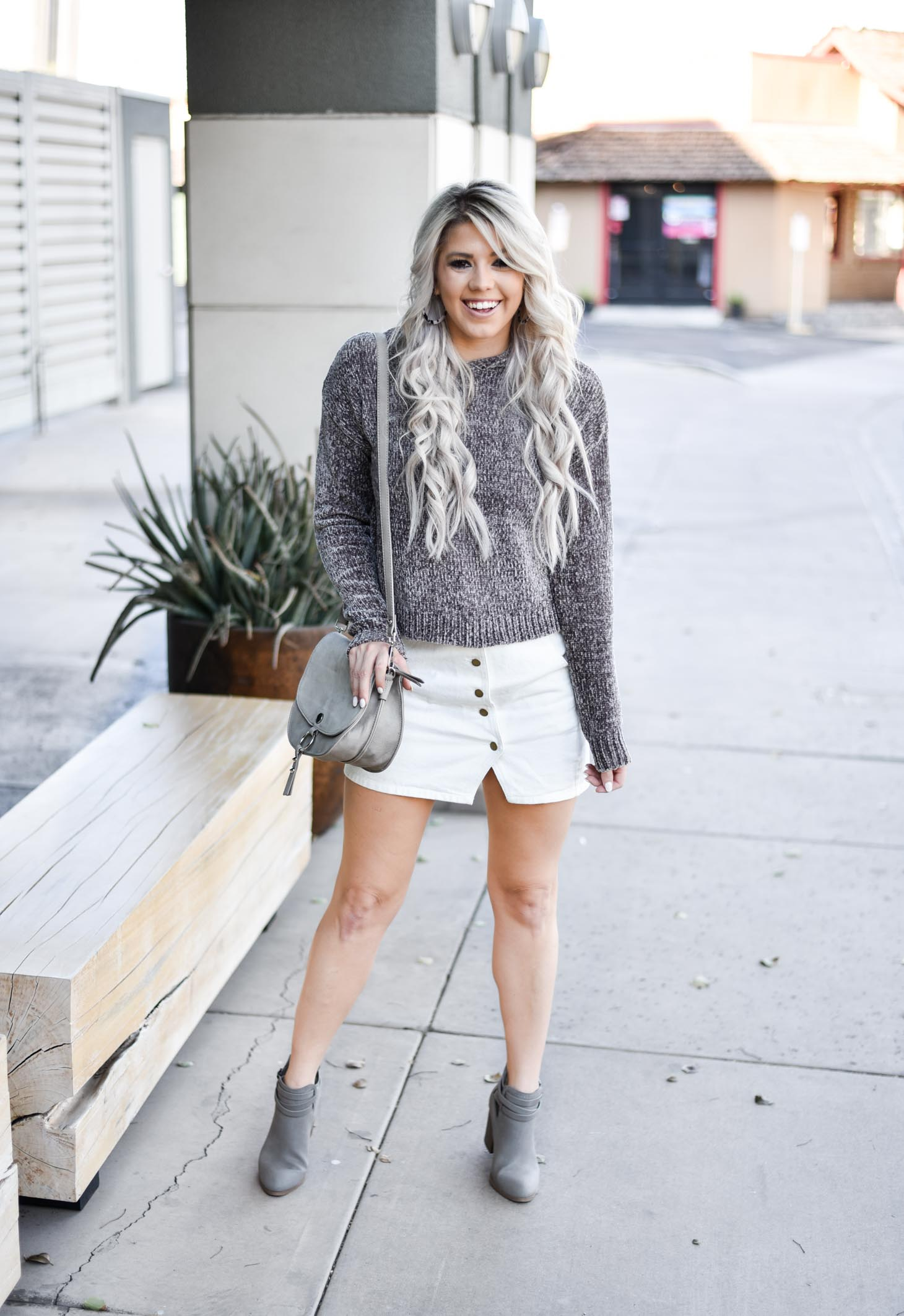 Erin Elizabeth of Wink and a Twirl shares a fall look from Red Dress Boutique with a cute hooded sweater and white miniskirt