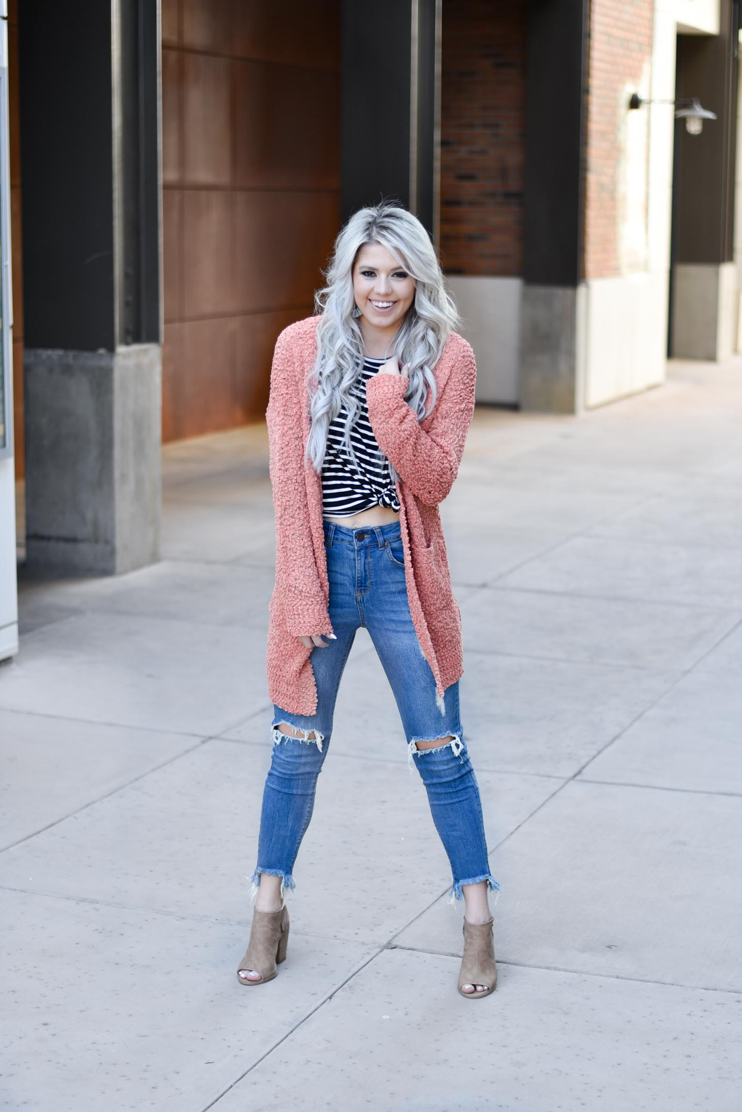 Erin Elizabeth of Wink and a Twirl shares two ways to style a striped top from Pink Lily Boutique perfect for your fall style this year