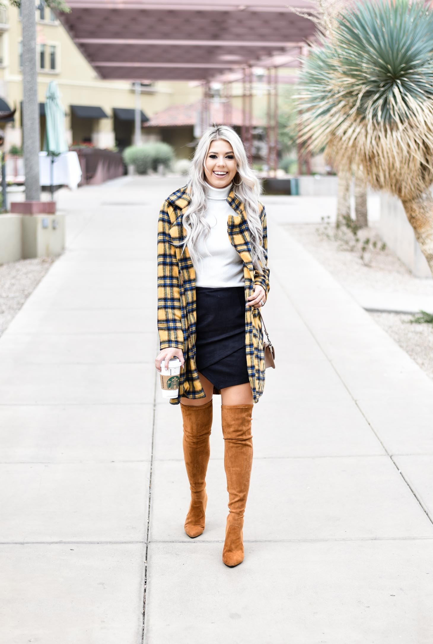 Erin Elizabeth of Wink and a Twirl shares this fabulous plaid coat from Shop Priceless