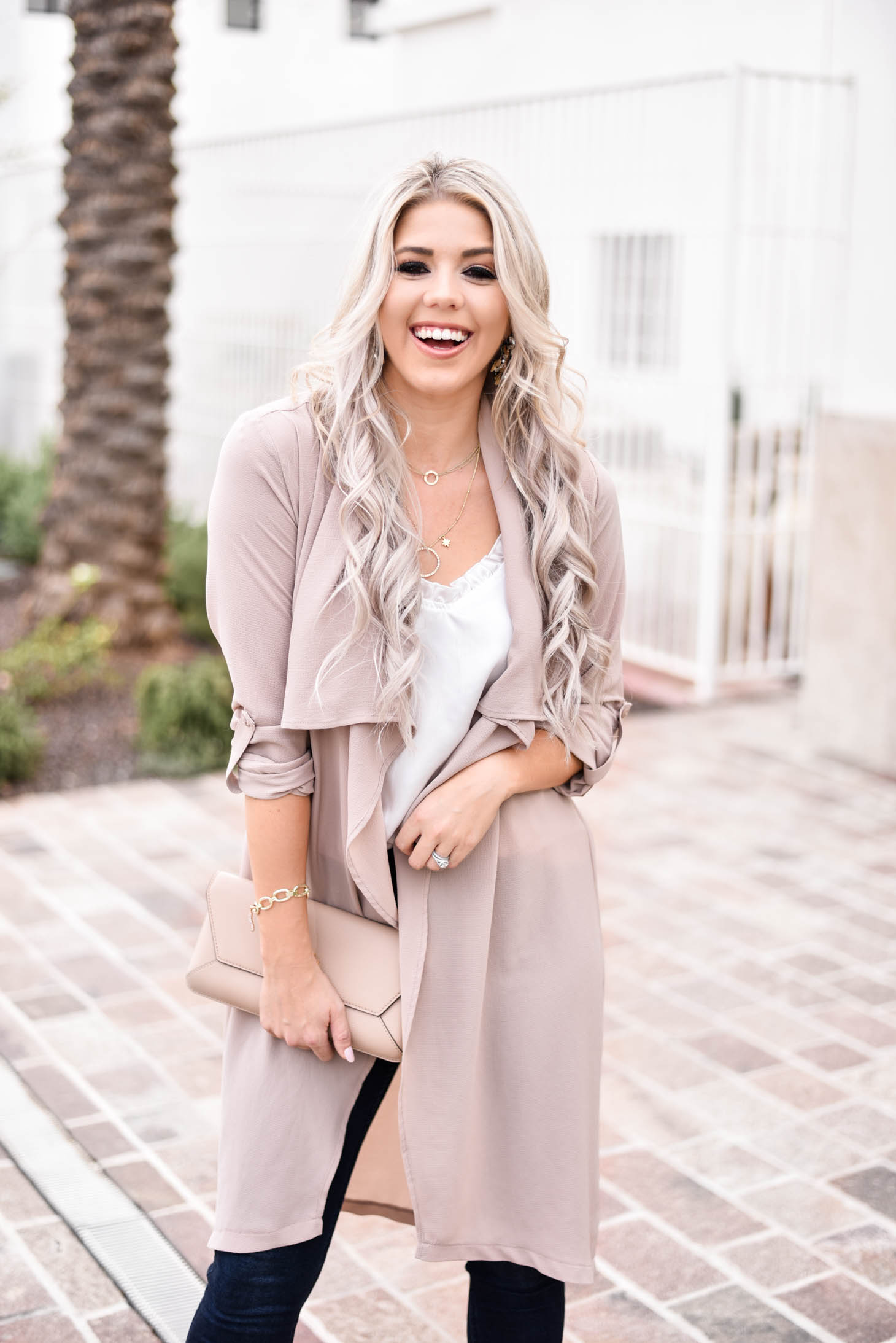 Erin Elizabeth of Wink and a Twirl shares the cutest blush duster and white cami from Fifth and Ivy