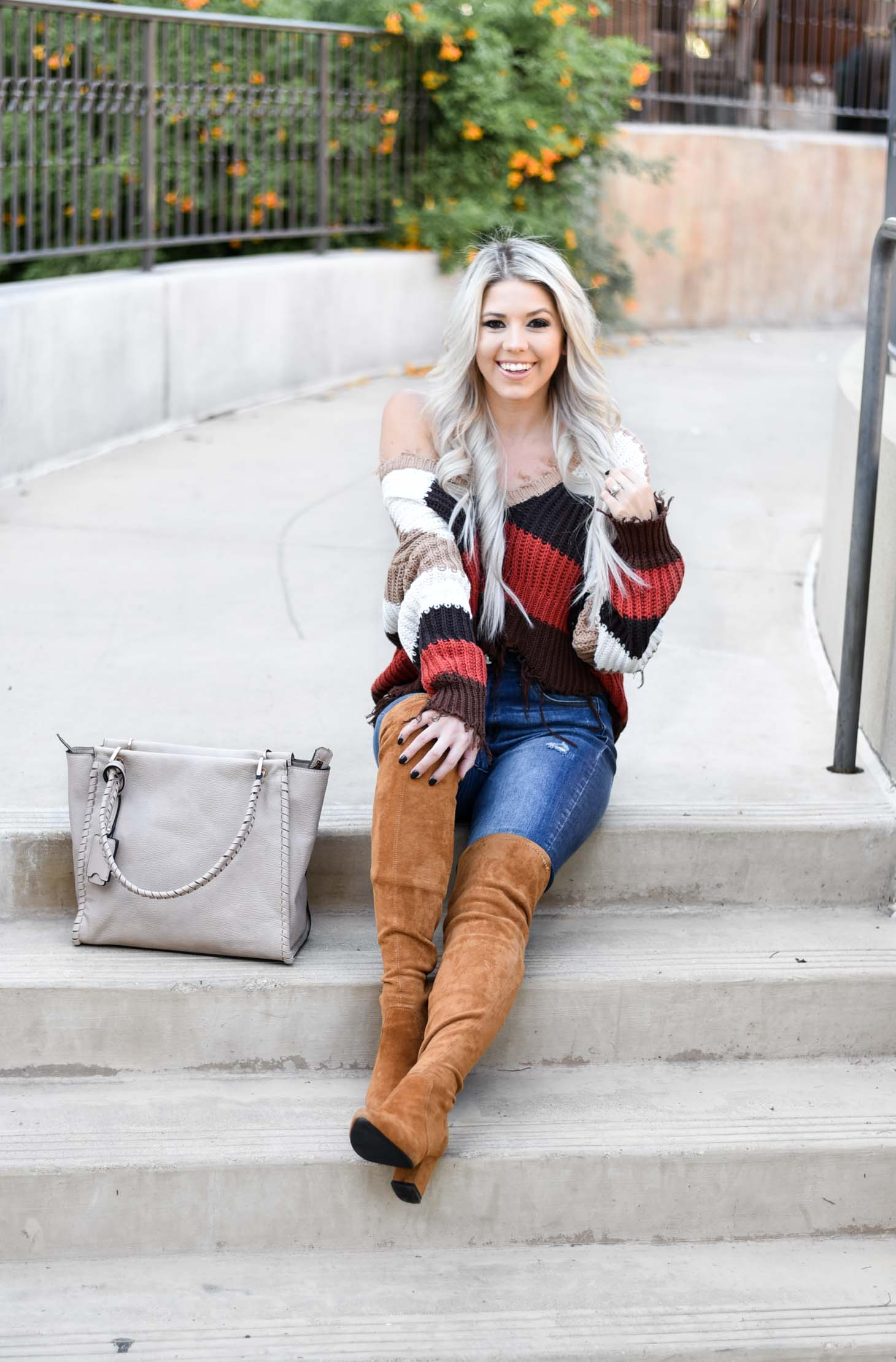 Erin Elizabeth of Wink and a Twirl shares the perfect distressed sweater and jeans from Red Dress Boutique