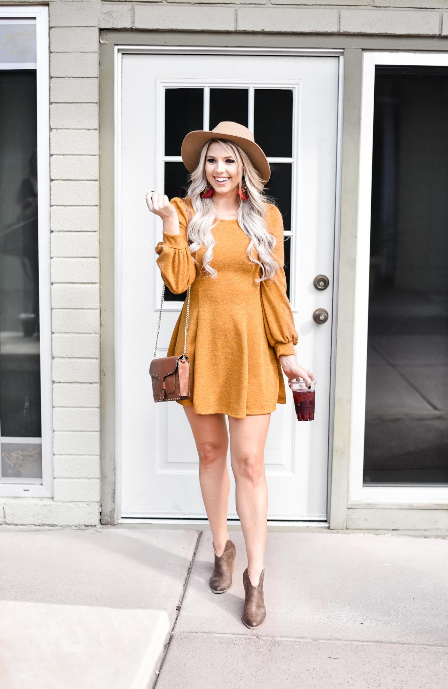 Erin Elizabeth of Wink and a Twirl shares the cutest fall sweater dress from Pink Lily Boutique