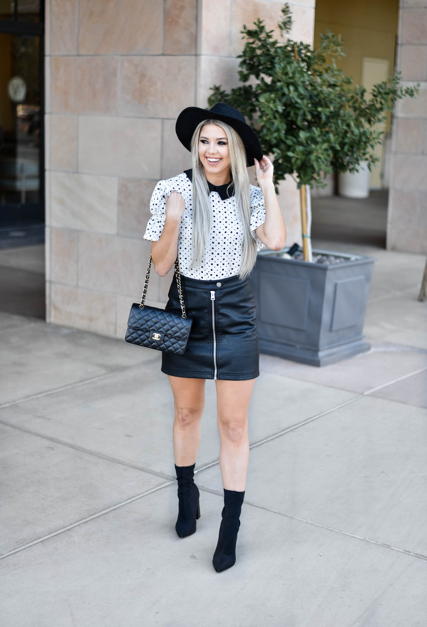 Erin Elizabeth of Wink and a Twirl shares the cutest CeCe Sportswear polka dot top and leather mini