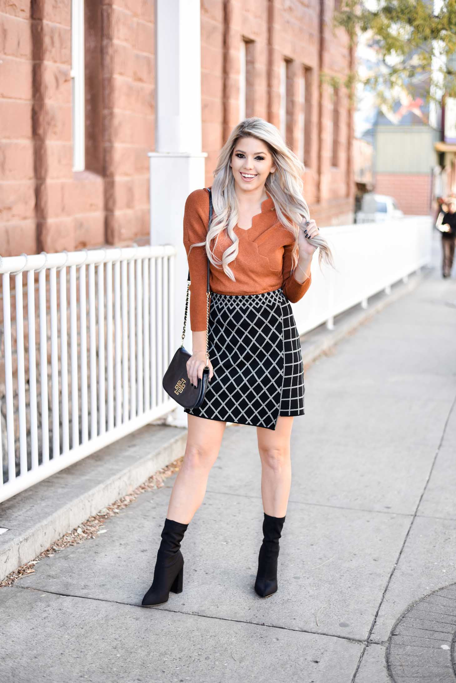 Erin Elizabeth of Wink and a Twirl shares the perfect Fall skirt and sweater combo from Chicwish