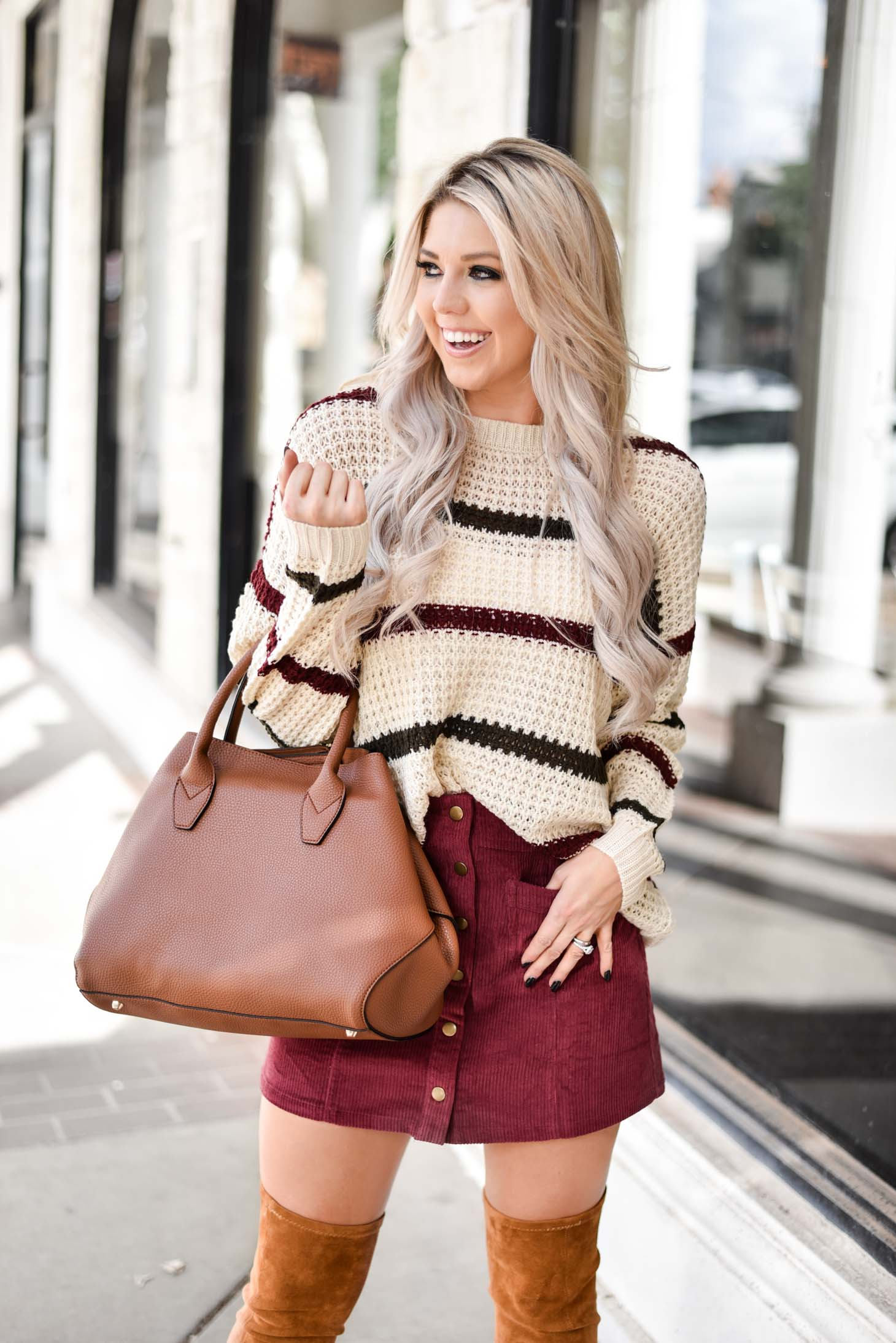 Erin Elizabeth of Wink and a Twirl shares the perfect fall skirt and sweater combo from Pink Lily Boutique