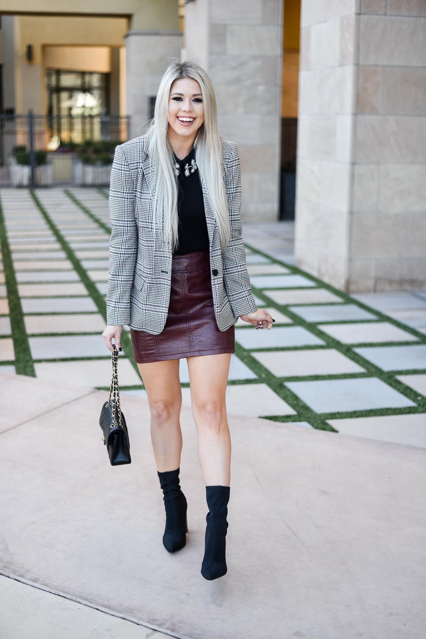 Erin Elizabeth of Wink and a Twirl shares the perfect way to style a leather mini this fall
