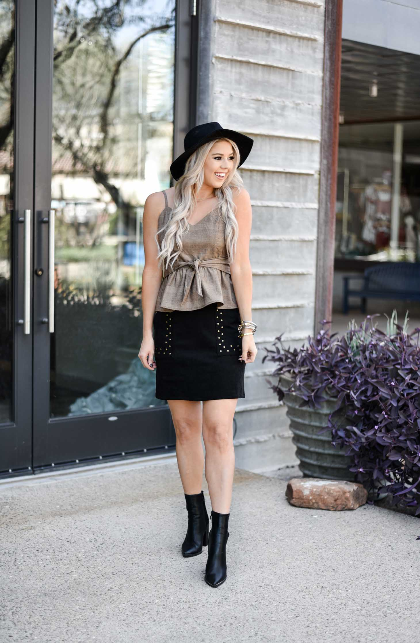Erin Elizabeth of Wink and a Twirl shares a cute skirt and boot look from Shop Sugar Lips
