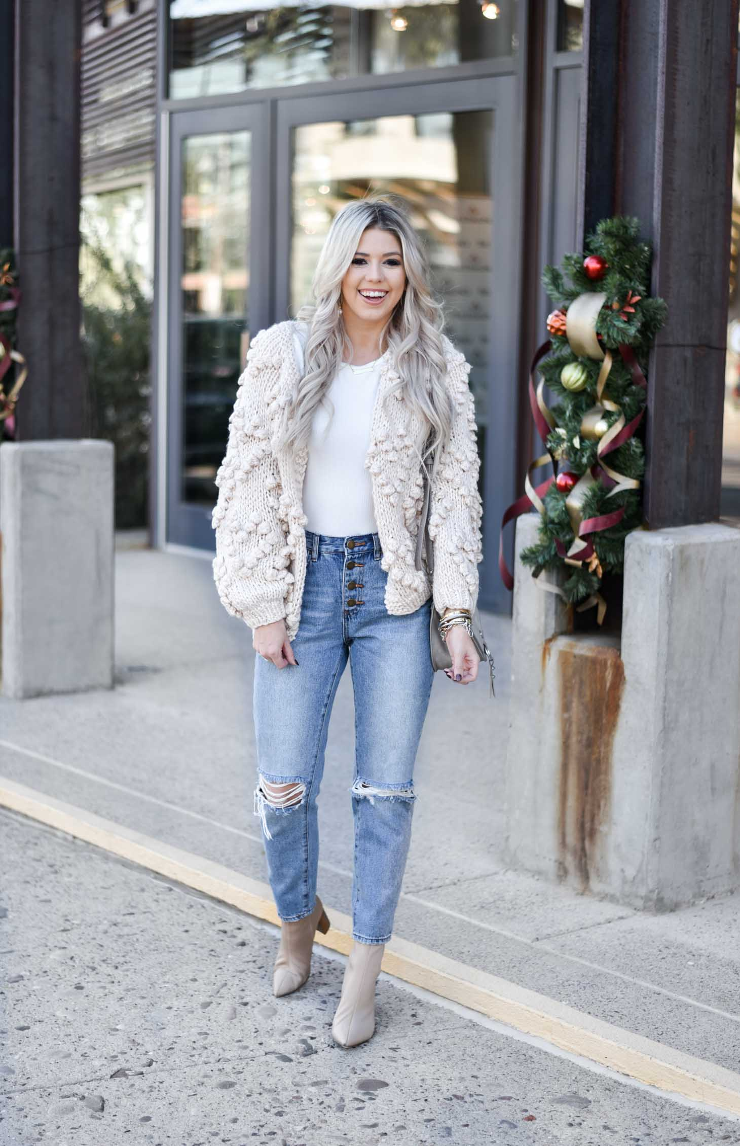 Erin Elizabeth of Wink and a Twirl shares the must have winter chunky cardigan from Chicwish