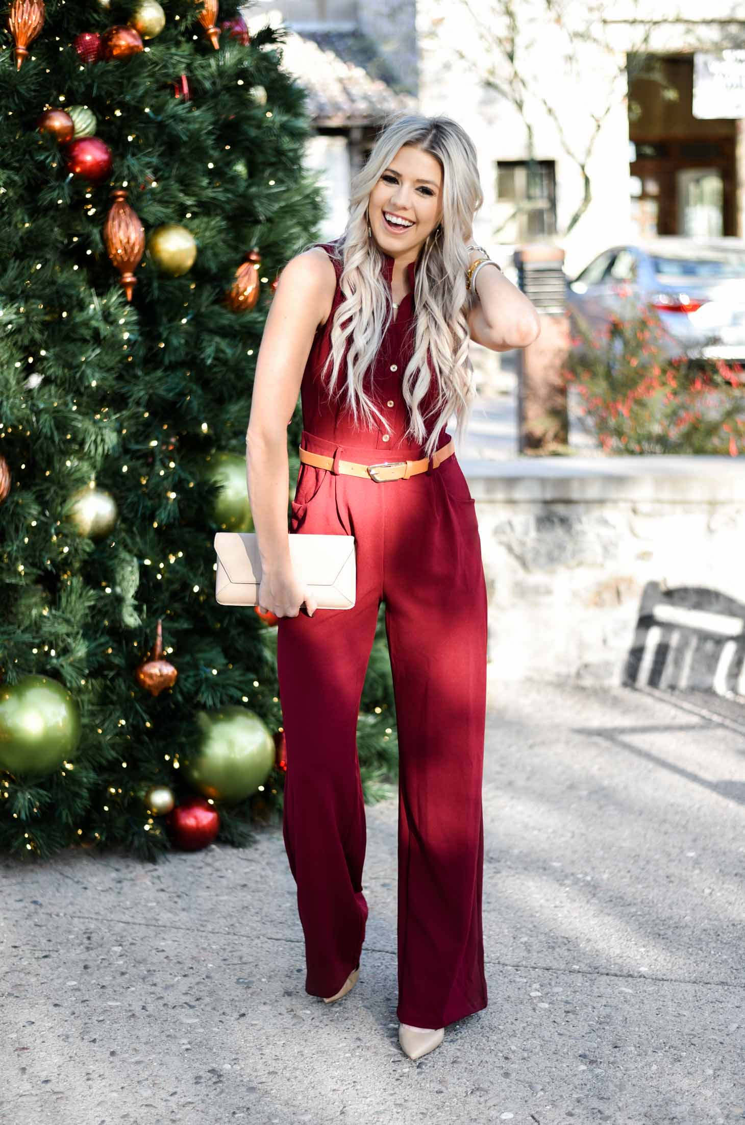 Erin Elizabeth of Wink and a Twirl share the perfect holiday jumpsuit from The Pink Lily Boutique