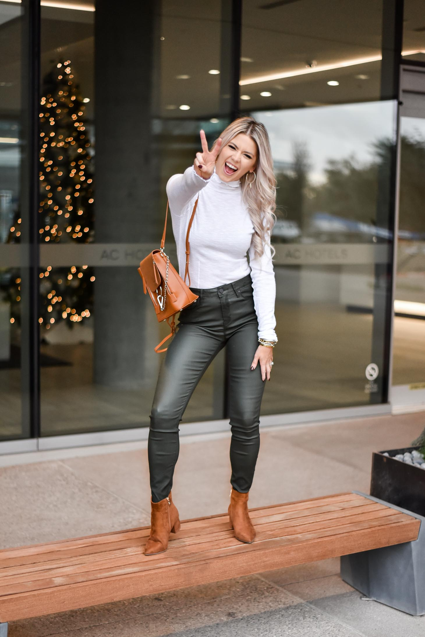 Erin Elizabeth of Wink and a Twirl shares the perfect leather pants and turtleneck look from Lulus during her stay at the AC Hotel Phoenix Biltmore in Phoenix, Arizona