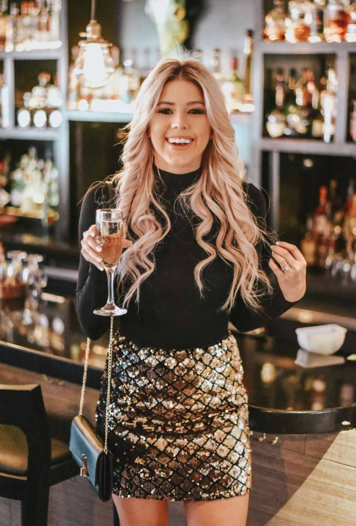 Erin Elizabeth of Wink and a Twirl shares her go to New Years Eve look from Red Dress Boutique, as well as other New Years Eve Looks