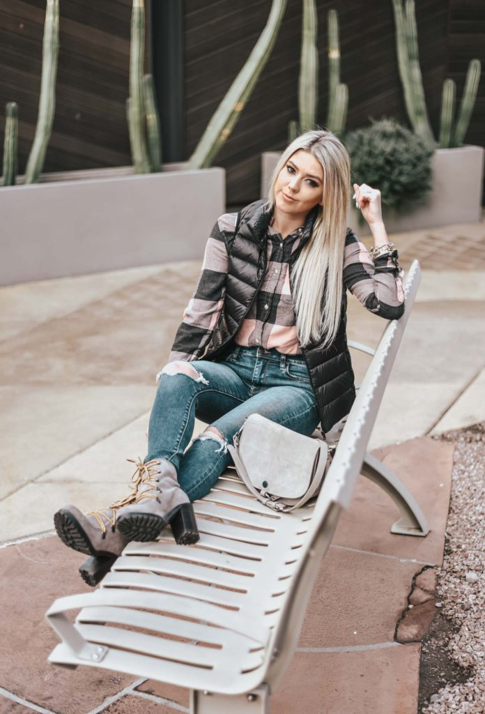 Erin Elizabeth of Wink and a Twirl shares the perfect plaid top and black puffer vest! A perfect casual, winter look!
