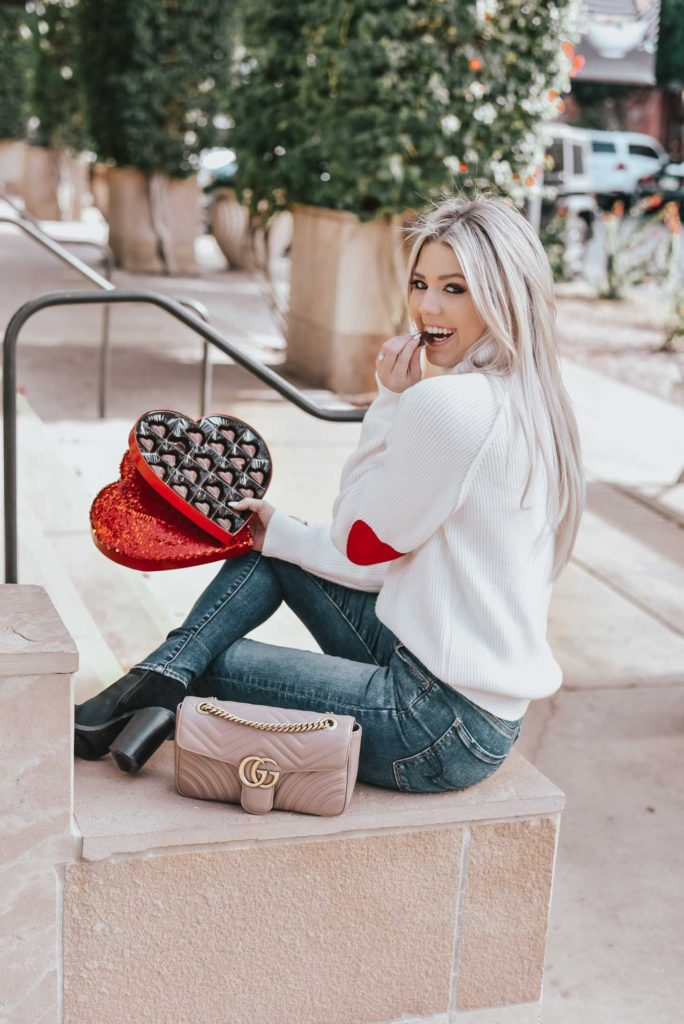 Erin Elizabeth of Wink and a Twirl shares the perfect heart elbow sweater from Chicwish, as well as some other super cute VDay Sweaters