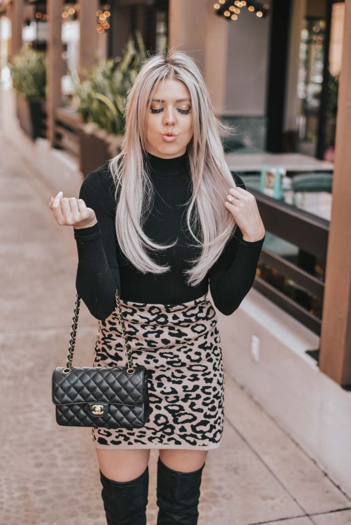 Erin Elizabeth of Wink and a Twirl shares the perfect leopard skirt and black turtleneck look Chiswish