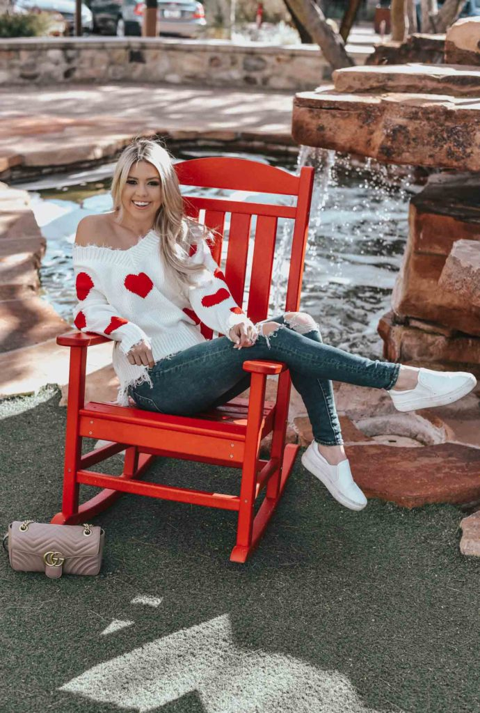 Erin Elizabeth of Wink and a Twirl shares the cutest heart sweater for Valentine's Day from Magnolia Boutique